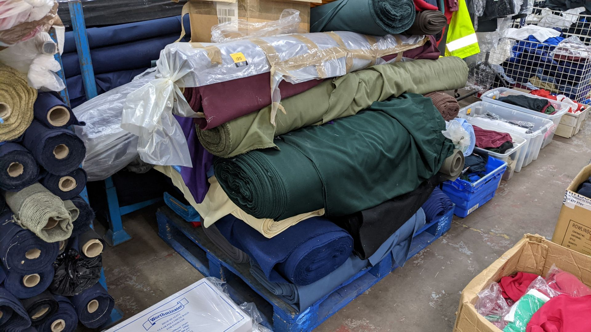 The contents of a pallet of assorted fabric