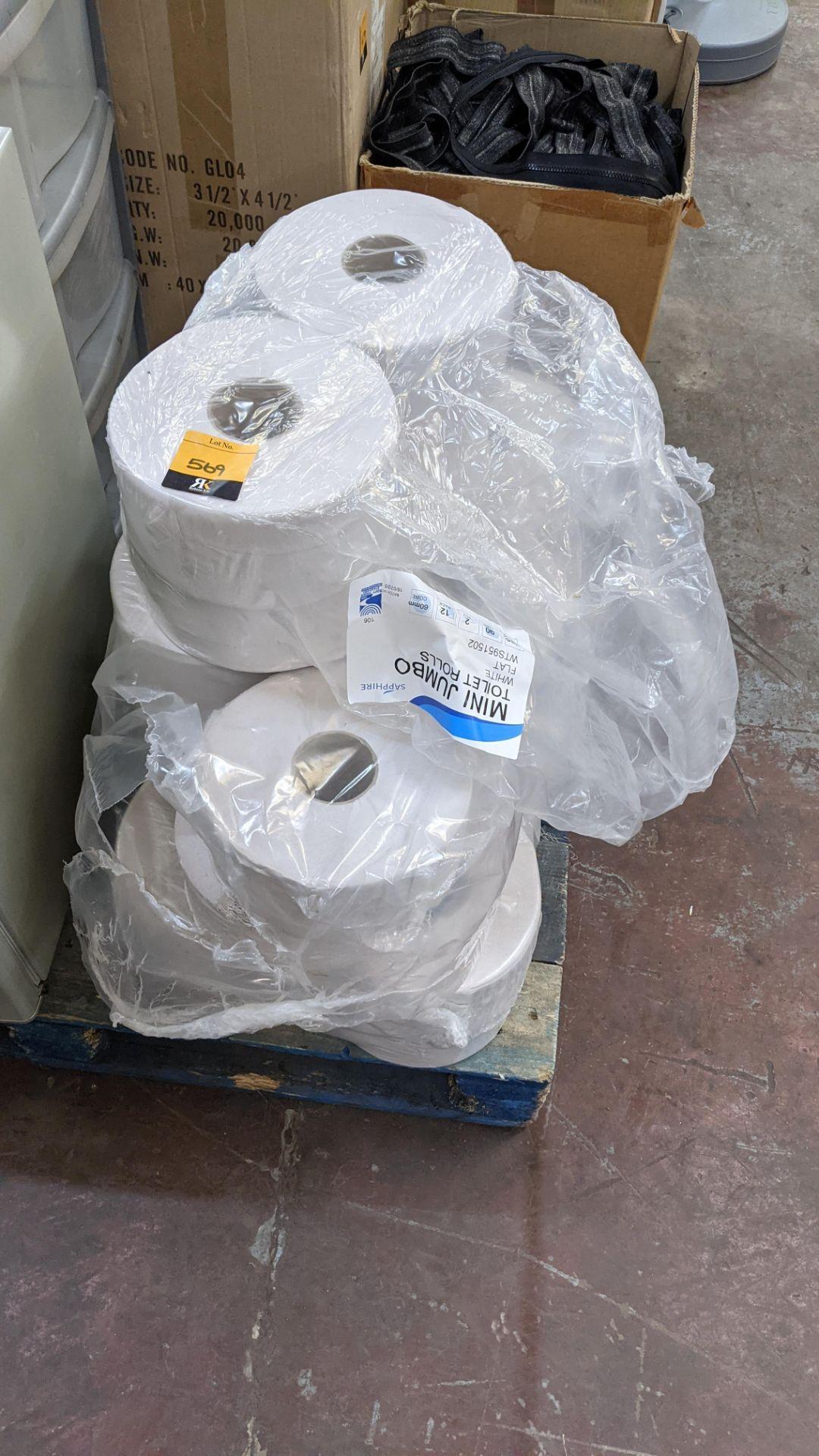 Quantity of white mini jumbo toilet rolls