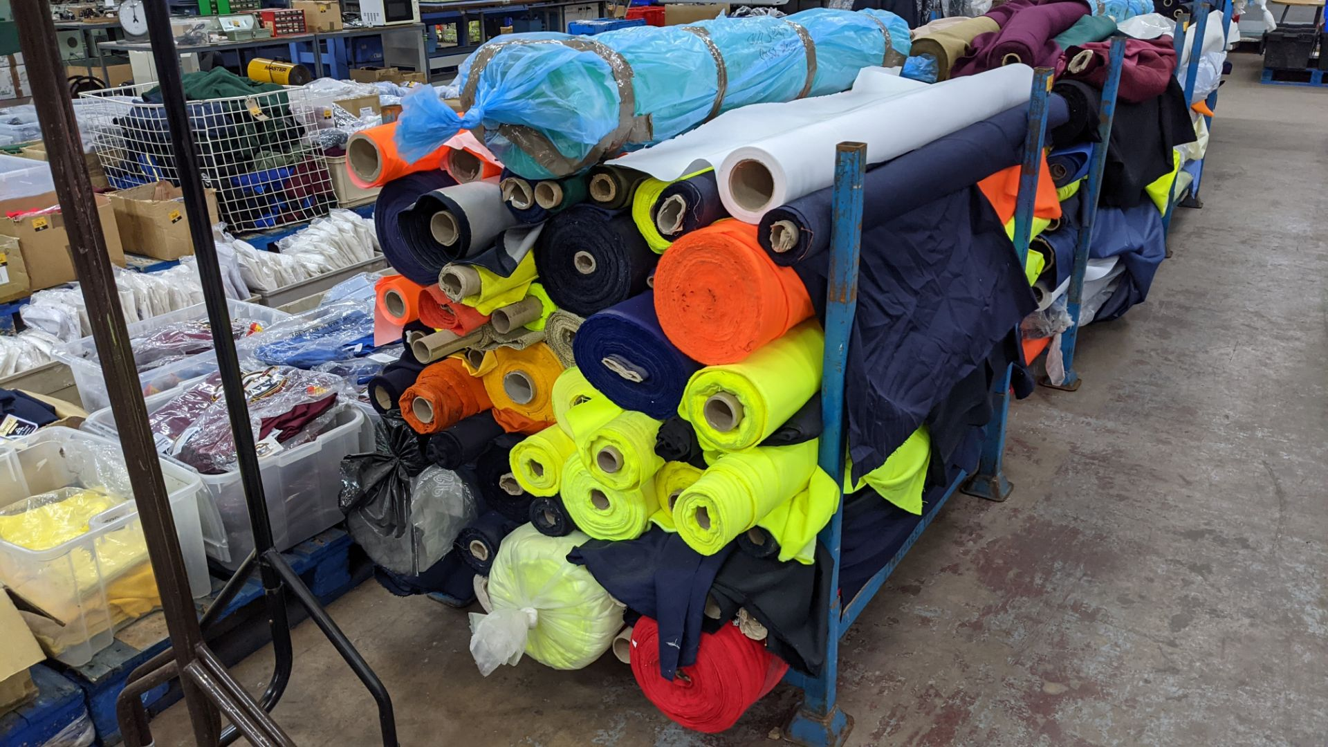 The contents of a large stillage of fabric including quantity of high visibility cloth. Please note - Image 3 of 10