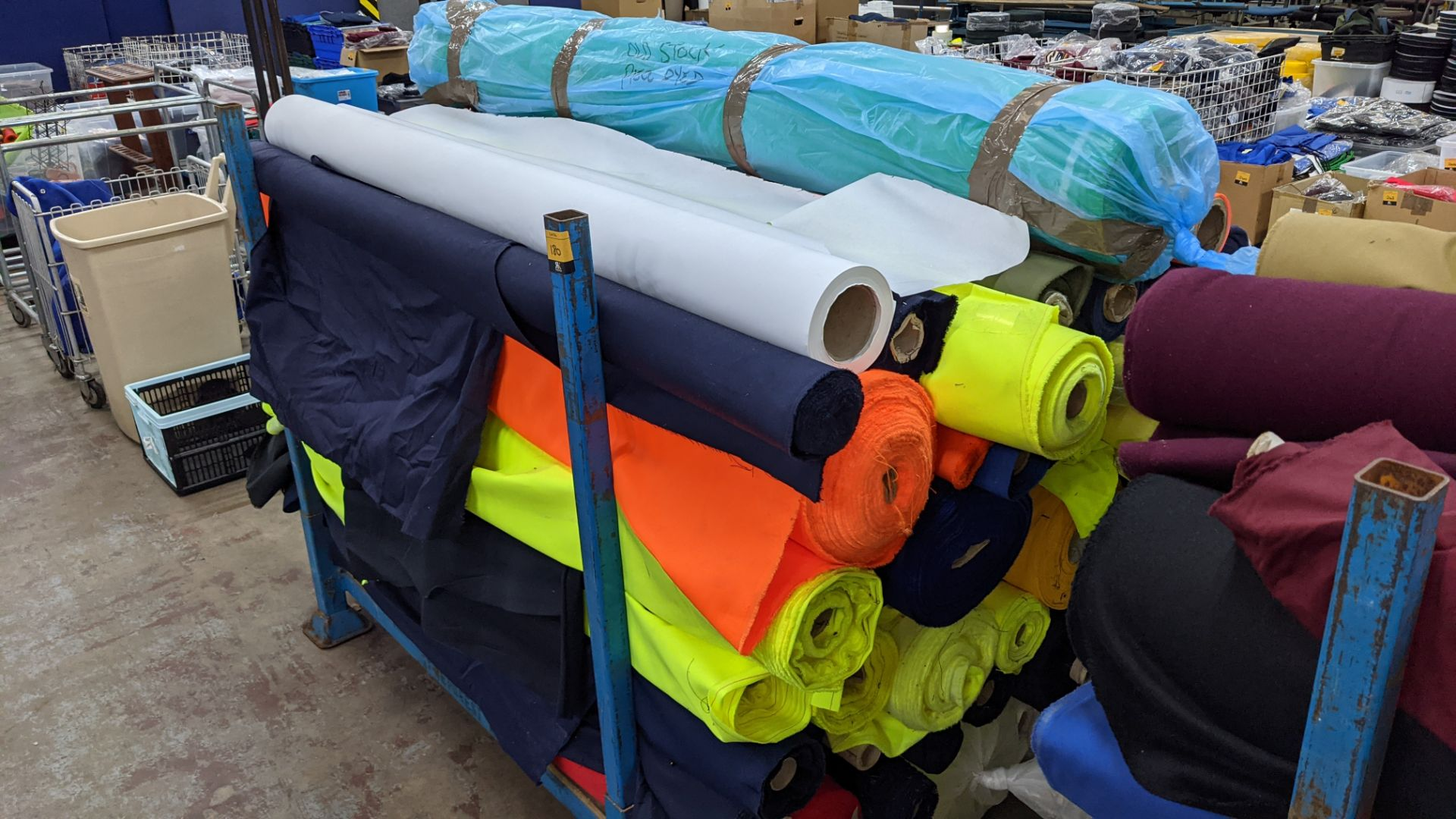 The contents of a large stillage of fabric including quantity of high visibility cloth. Please note - Image 9 of 10