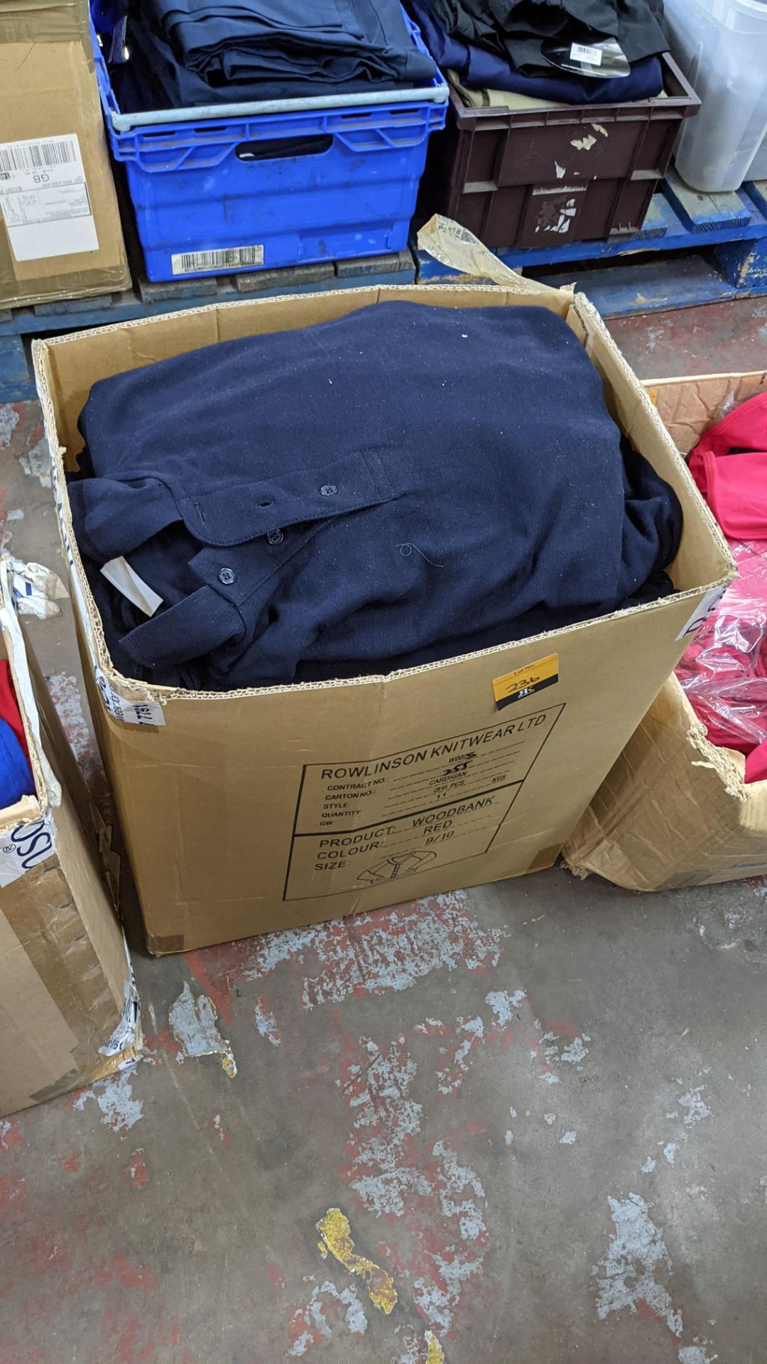 Quantity of navy polo shirts in assorted styles - 1 large box