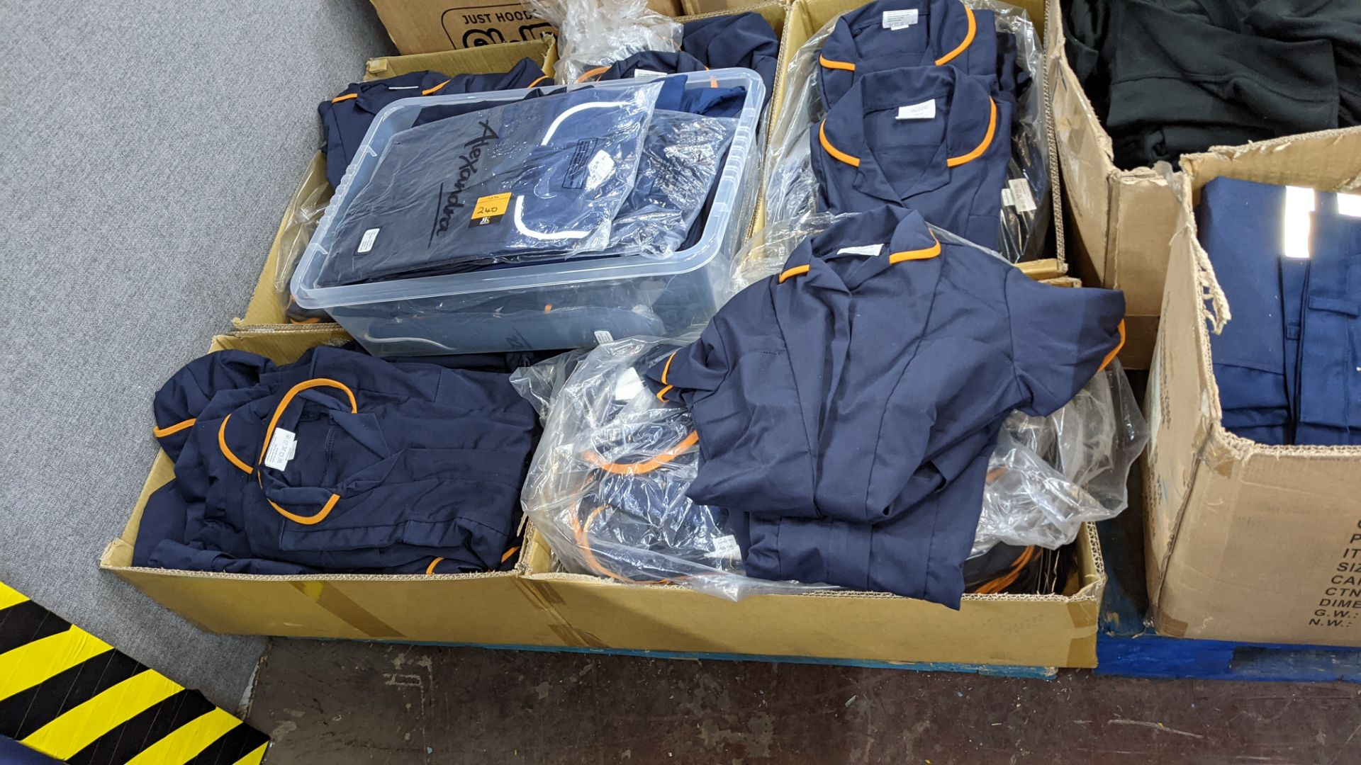 The contents of a pallet of short sleeve zip up navy tops with white or orange collars - this lot co - Image 2 of 6