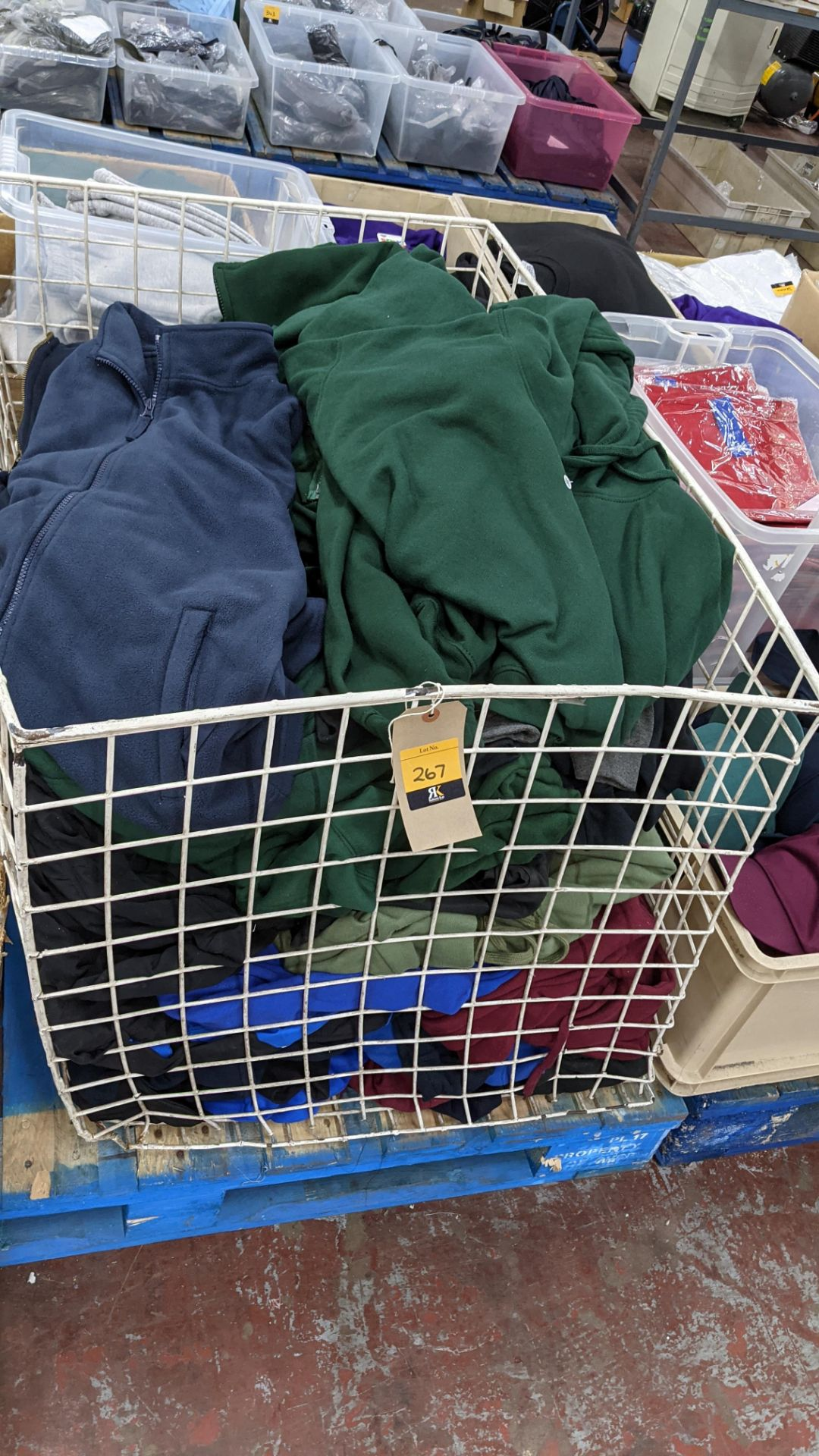 Large quantity of fleece tops - the contents of large cage. NB cage excluded