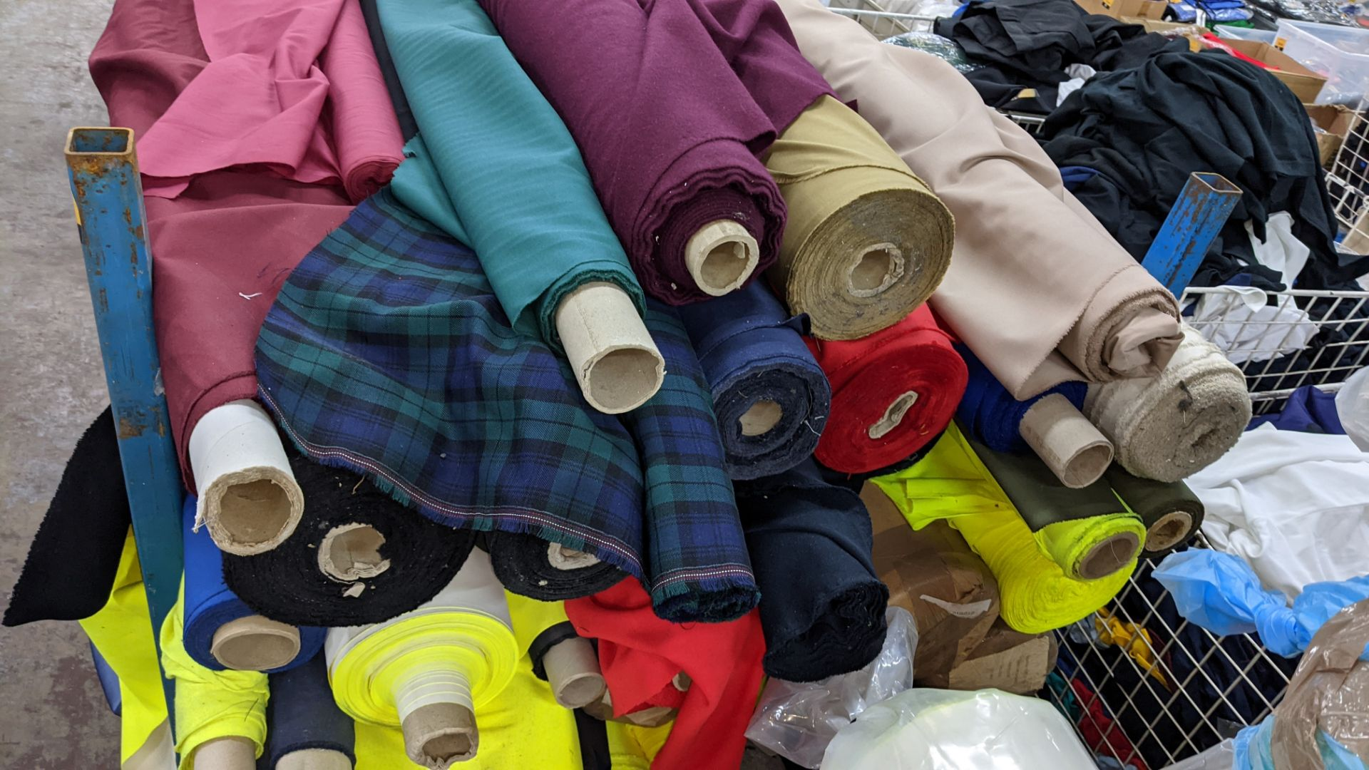 The contents of a large stillage of fabric including quantity of high visibility cloth. Please note - Image 7 of 9