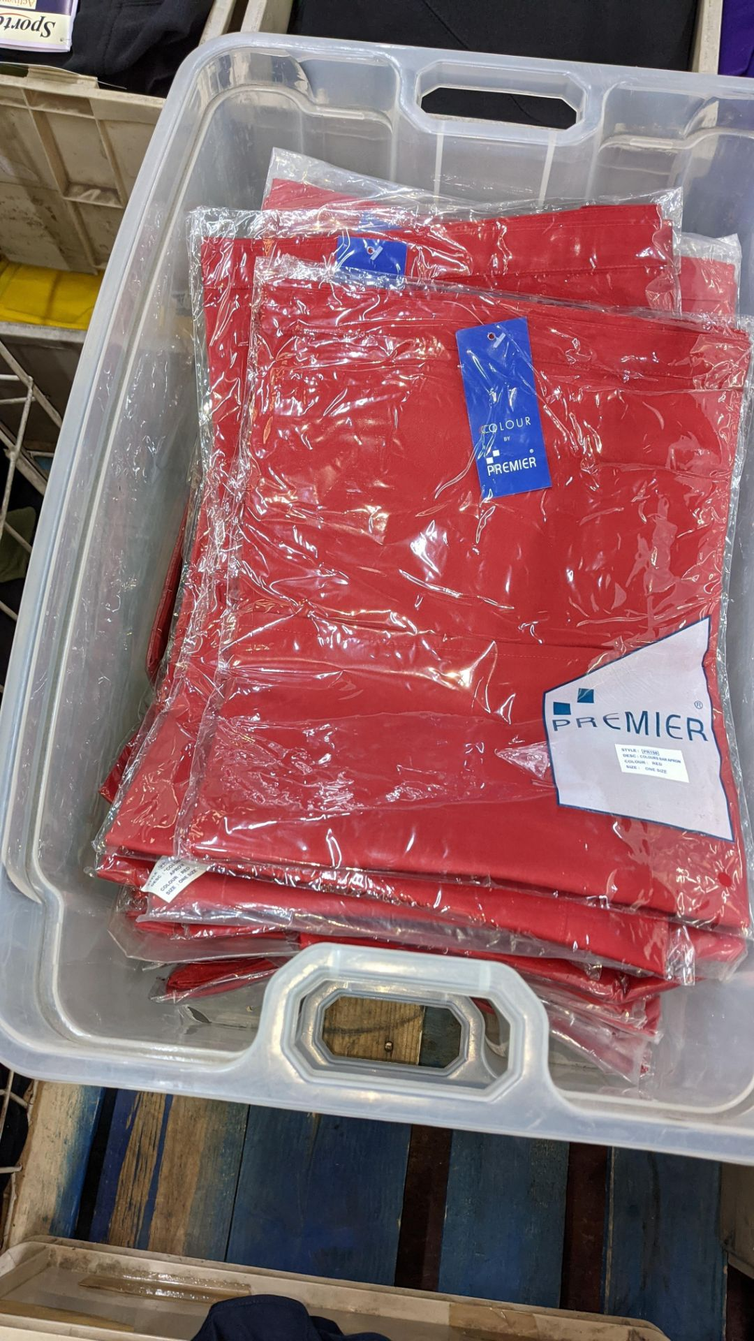 Approx 60 off red aprons - the contents of 2 crates. NB crates excluded - Image 2 of 6