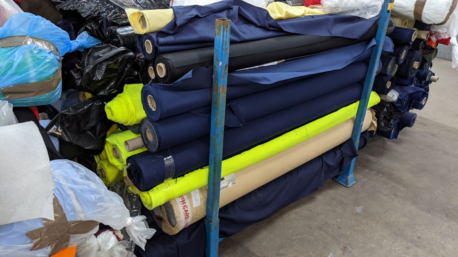 The contents of a large stillage of fabric including quantity of high visibility cloth. Please note - Image 2 of 8