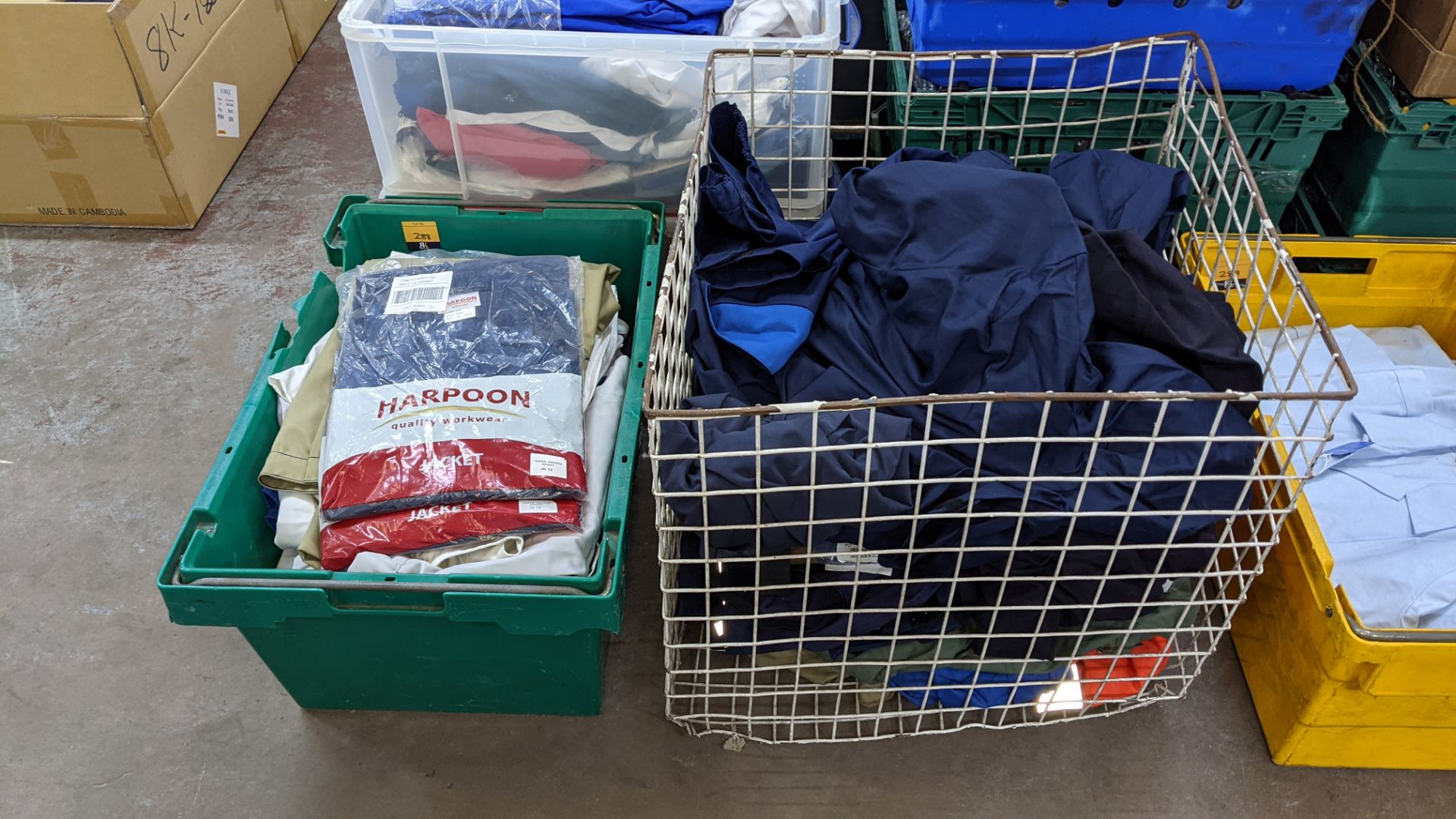 The contents of 1 crate & 1 large cage of assorted workwear jackets & similar. NB crate/cage exclu