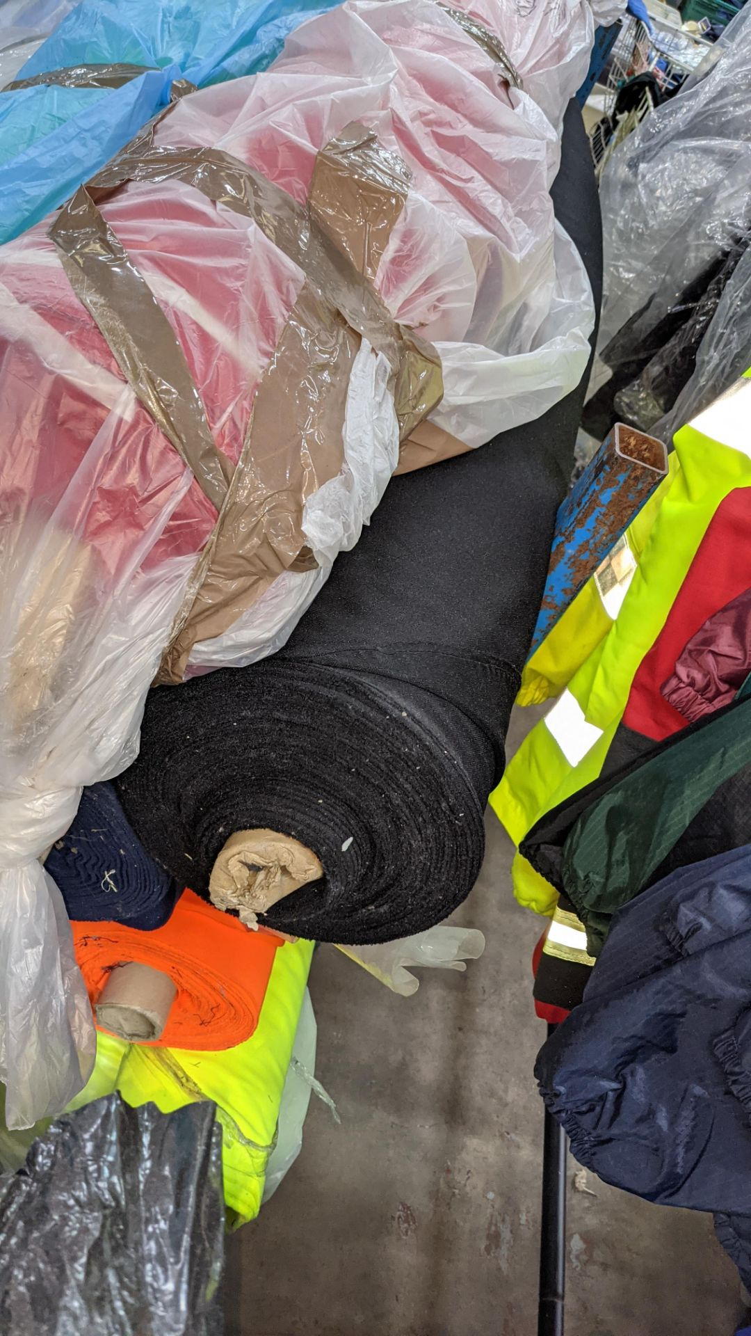 The contents of a large stillage of fabric including quantity of high visibility cloth. Please note - Image 12 of 12