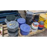 Quantity of reels of what is assumed to be belt fabric, in a variety of colours, in 8 stacks