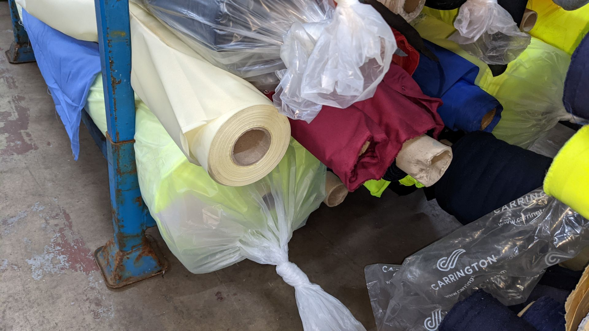 The contents of a large stillage of fabric including quantity of high visibility cloth. Please note - Image 11 of 12