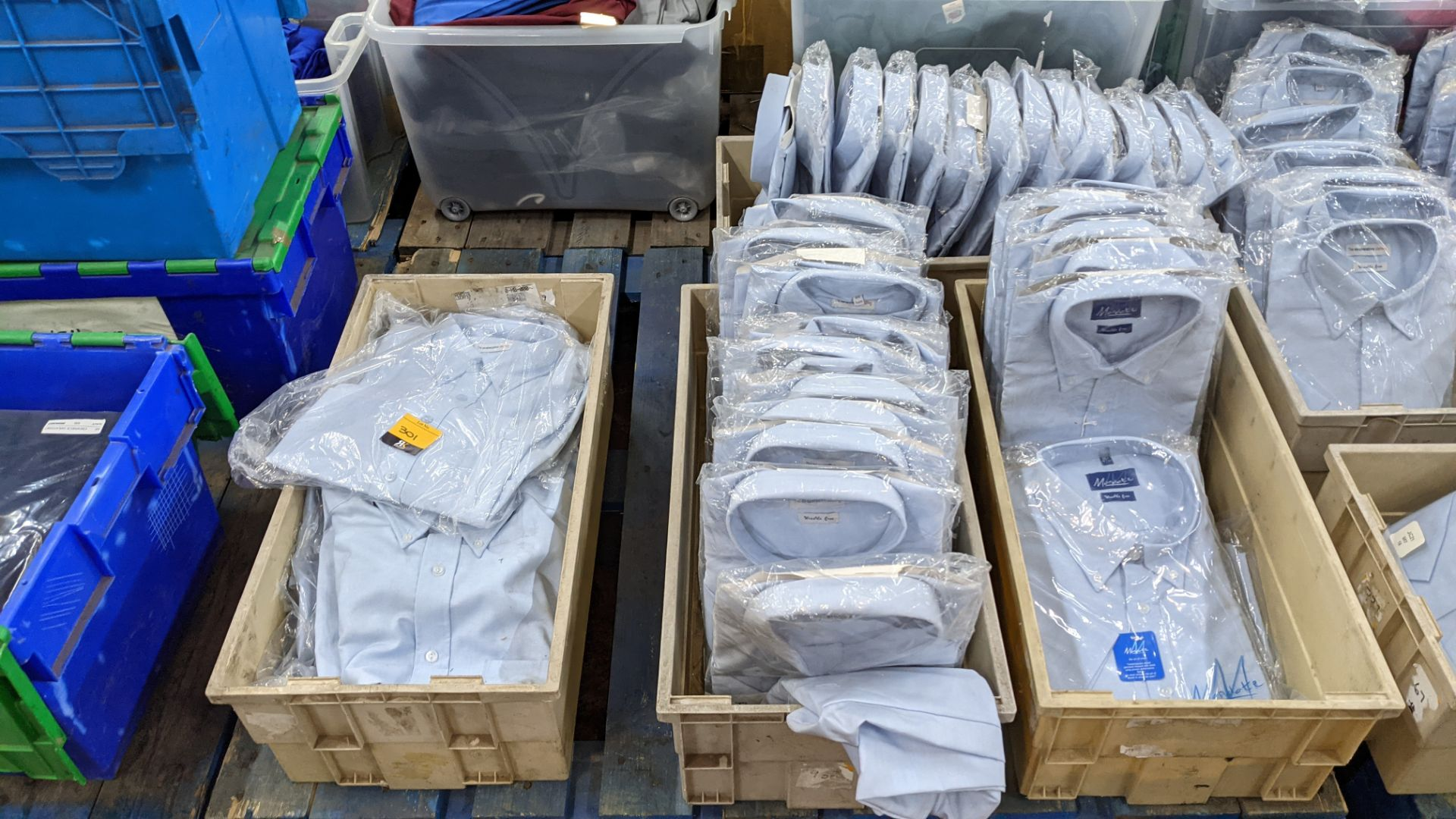 Approx 54 off blue shirts in assorted styles - the contents of 4 crates. NB crates excluded