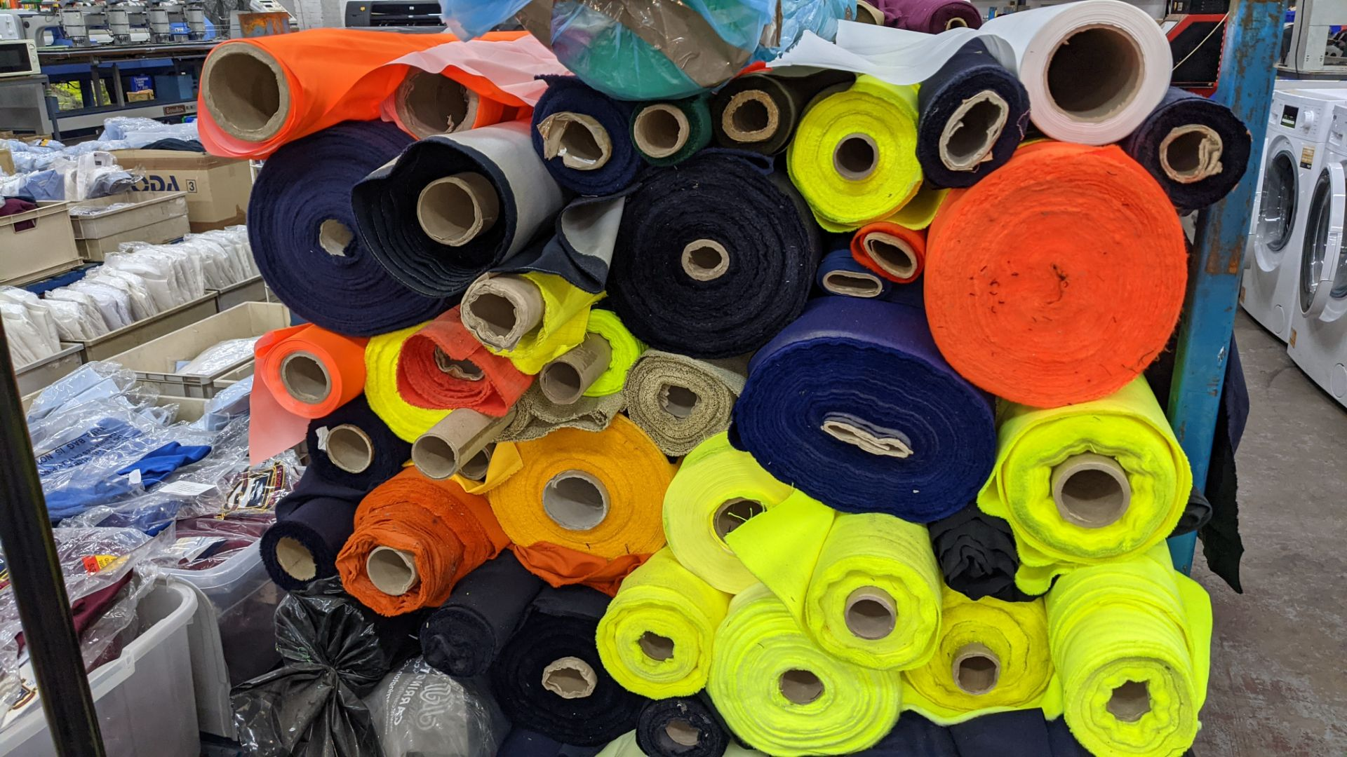 The contents of a large stillage of fabric including quantity of high visibility cloth. Please note - Image 5 of 10