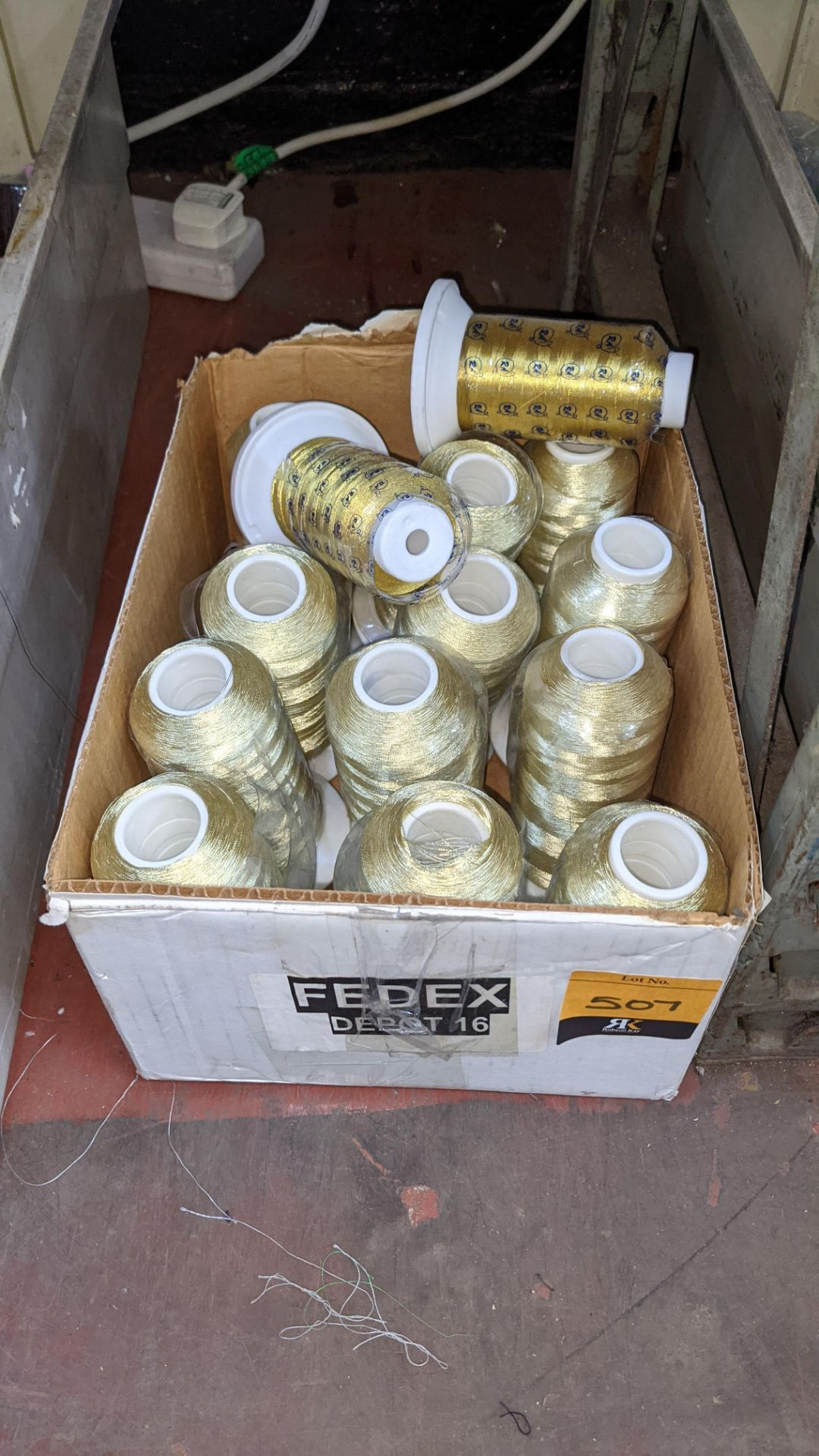"Box of gold thread, comprising 12 reels of metallic Euro glo & 2 reels of ""Gov't Gold"""
