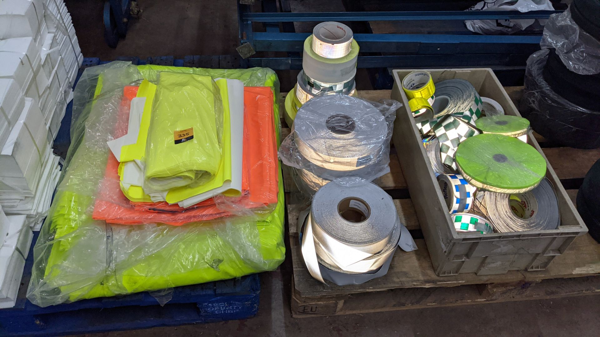 Quantity of hi-vis & reflective fabric & trim comprising 1 stack of fabric, 1 row of reels & the con