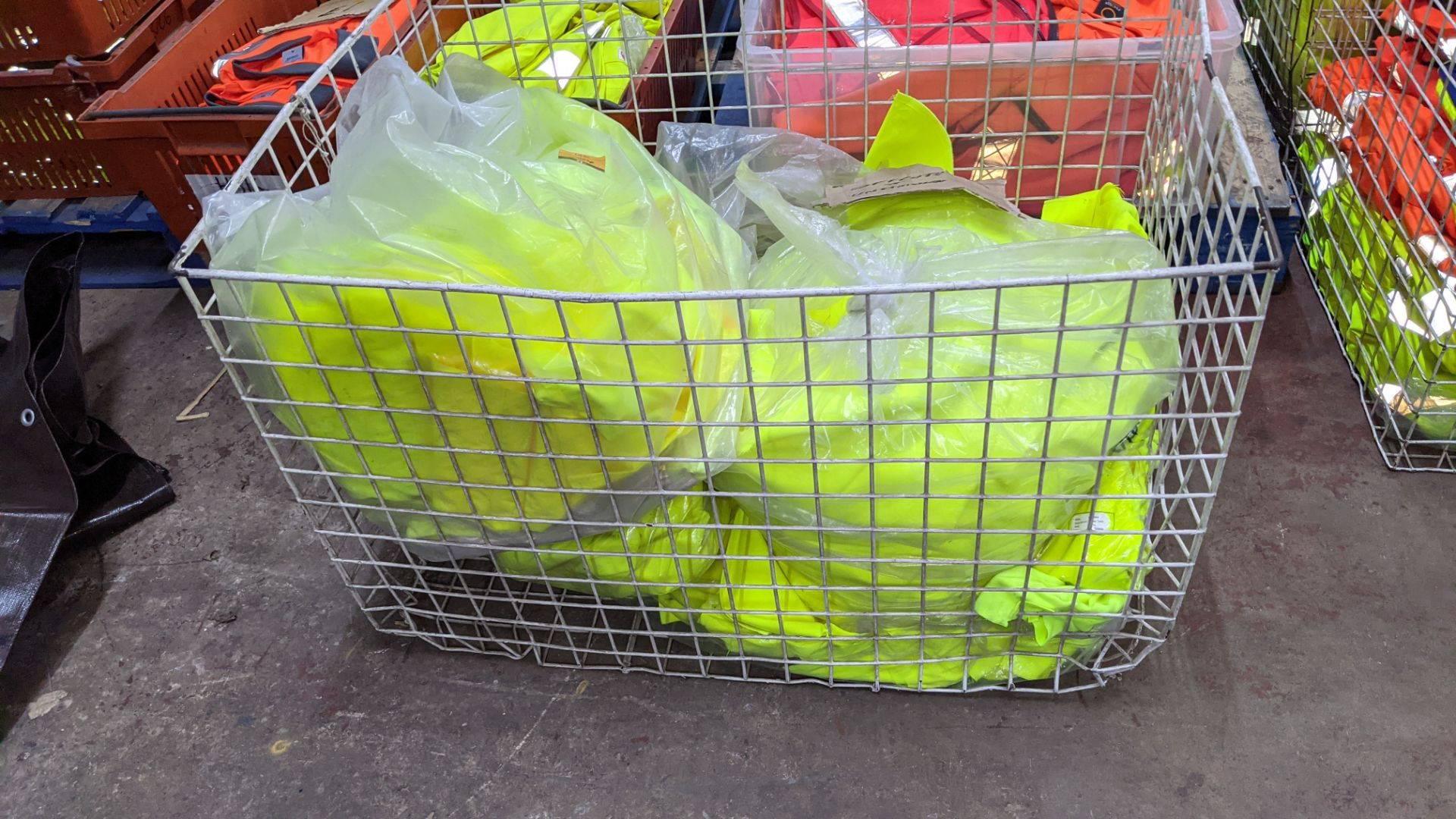 The contents of a cage of off-cuts & unfinished garments, all in yellow hi-vis fabrics. NB cage exc - Image 3 of 4