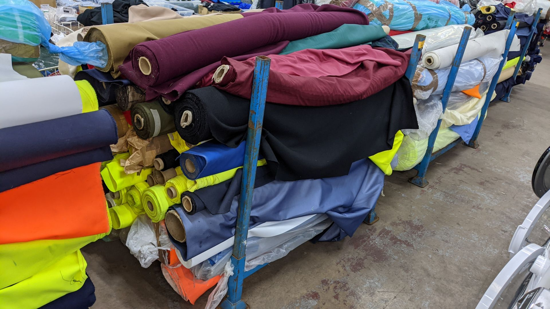 The contents of a large stillage of fabric including quantity of high visibility cloth. Please note - Image 2 of 9