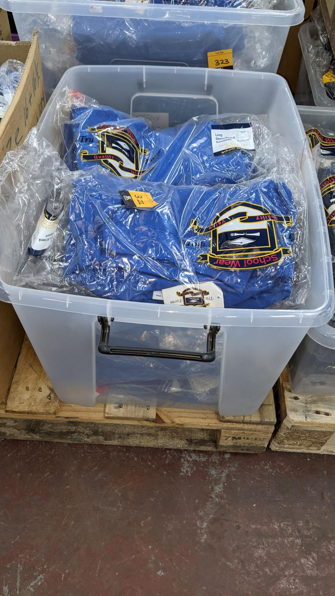 Approx 27 off blue children's sweatshirts & similar - the contents of 1 crate. NB crate excluded