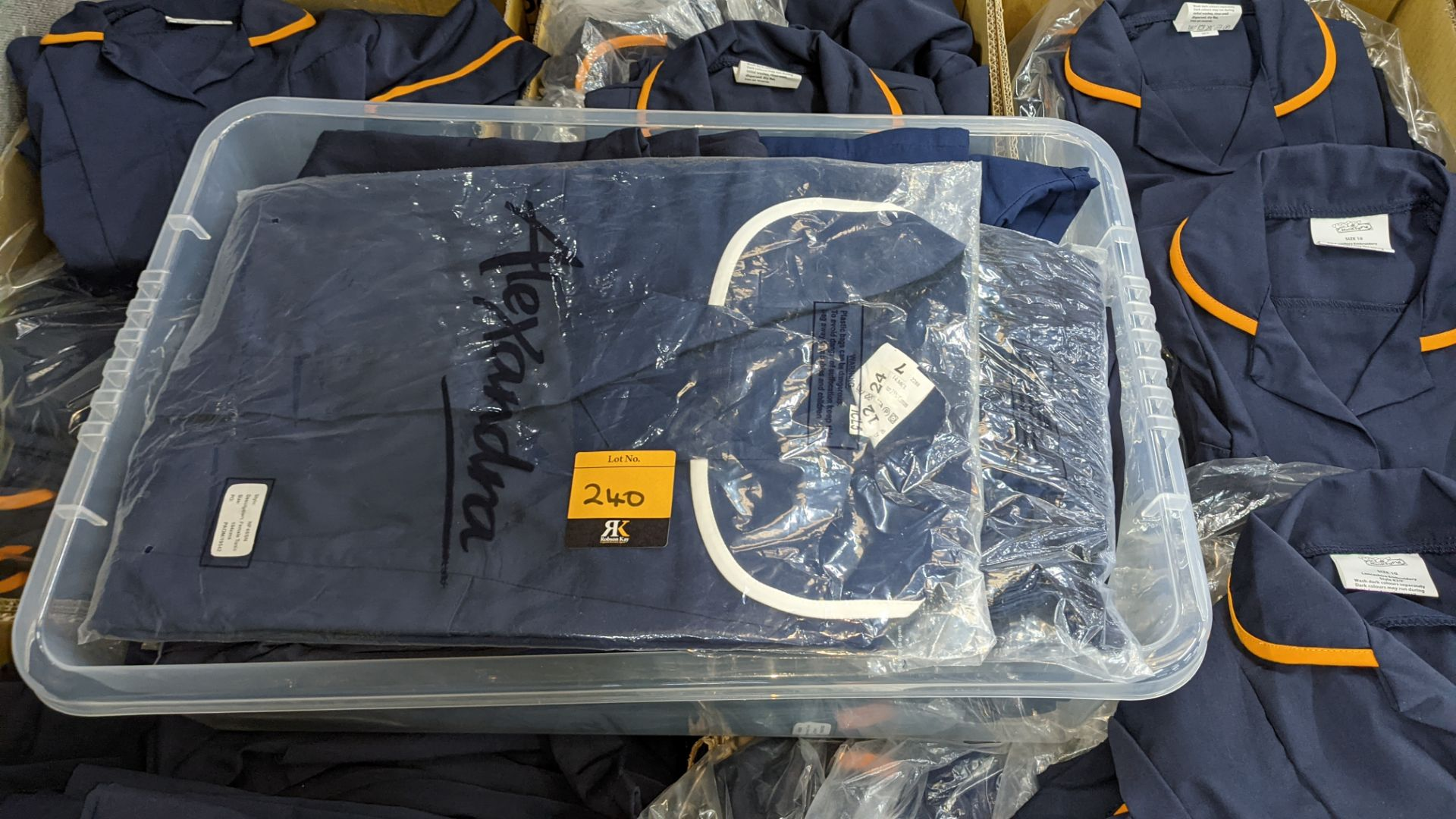 The contents of a pallet of short sleeve zip up navy tops with white or orange collars - this lot co - Image 3 of 6