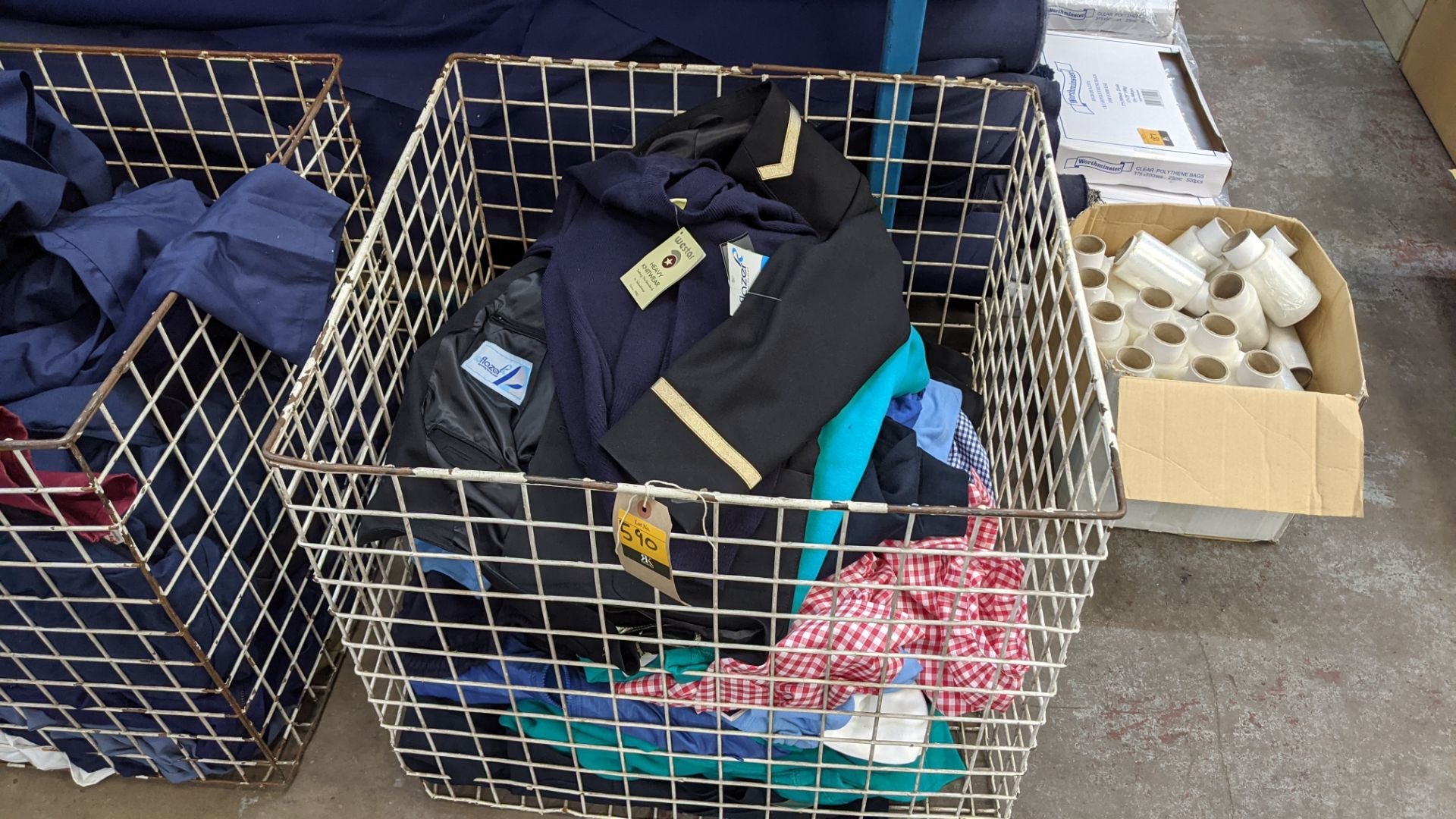 The contents of a cage of children's clothing, sweatshirts, t-shirts & more
