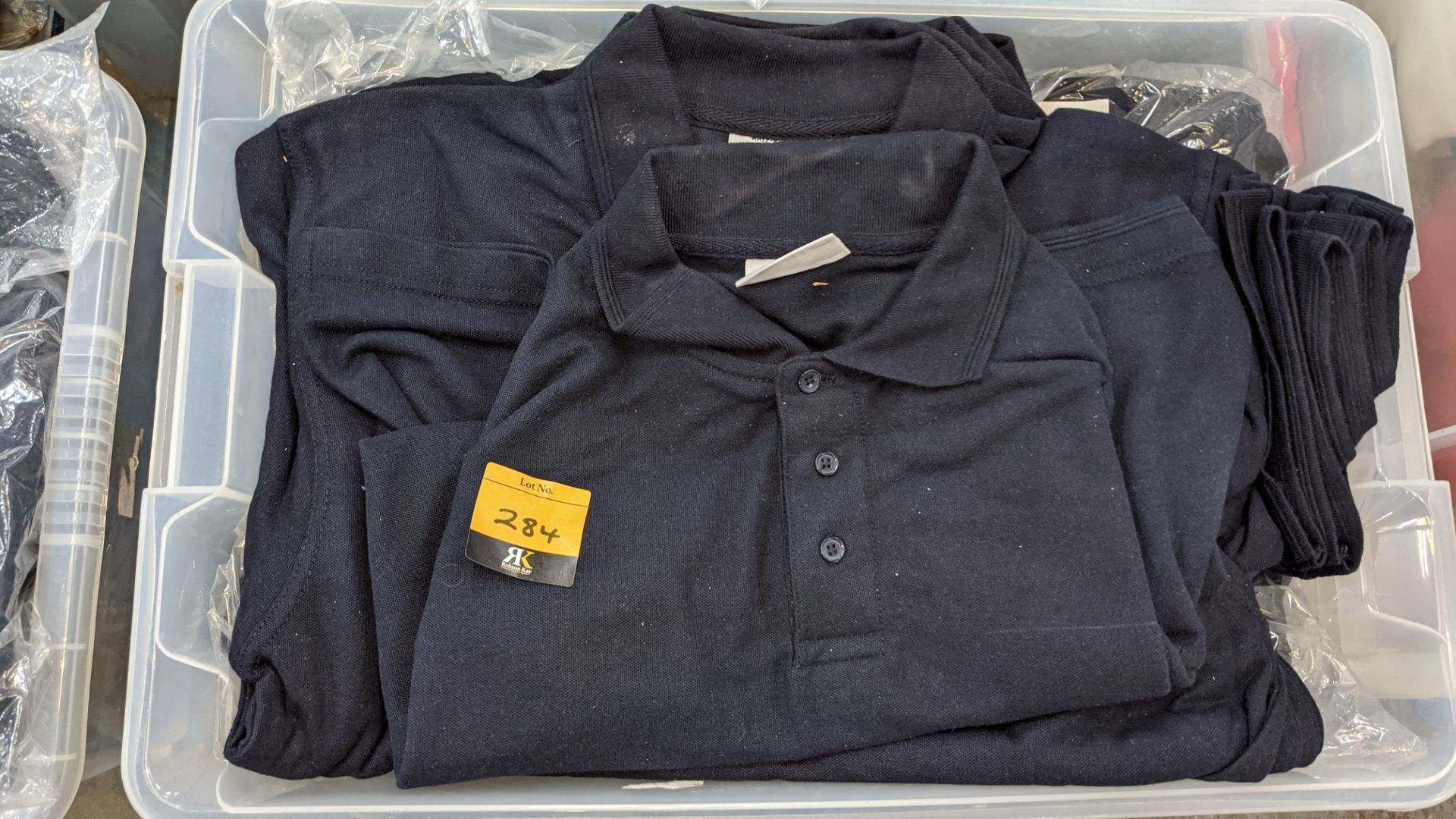 The contents of a crate of navy polo shirts. NB crate excluded - Image 3 of 5