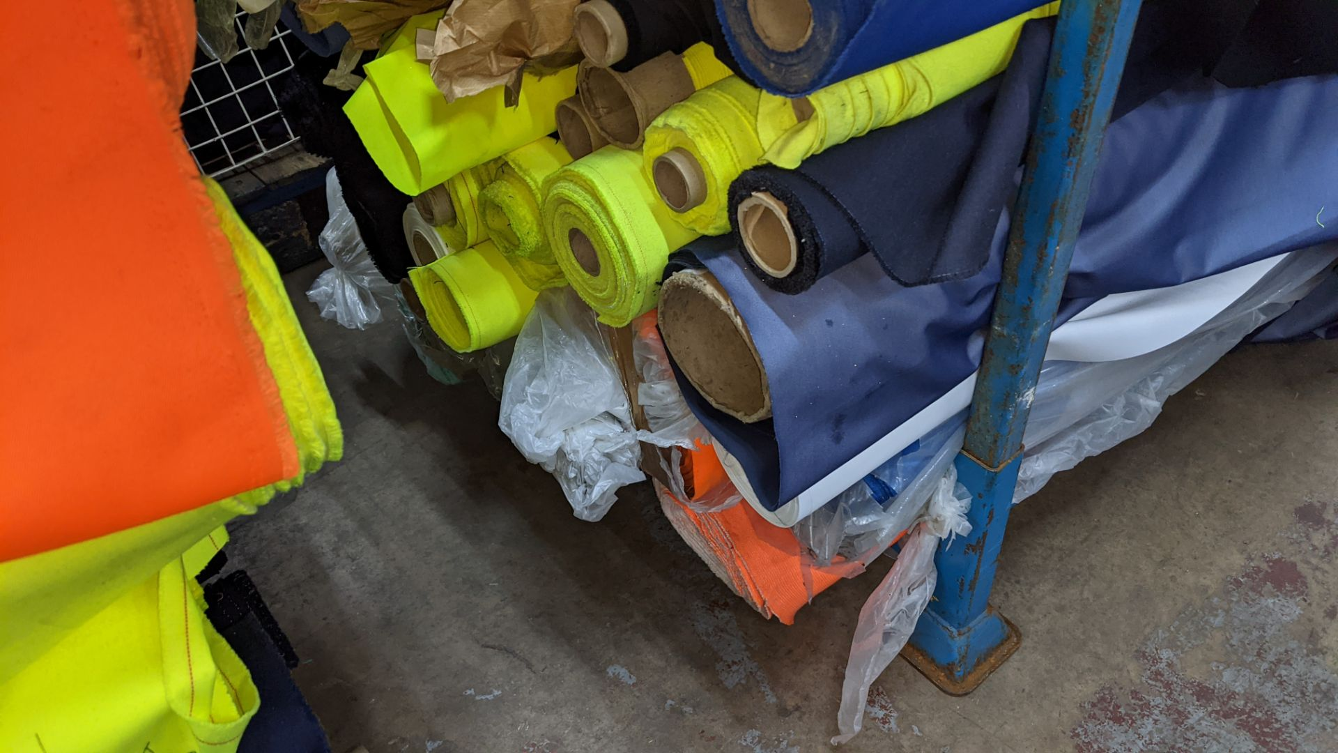 The contents of a large stillage of fabric including quantity of high visibility cloth. Please note - Image 5 of 9