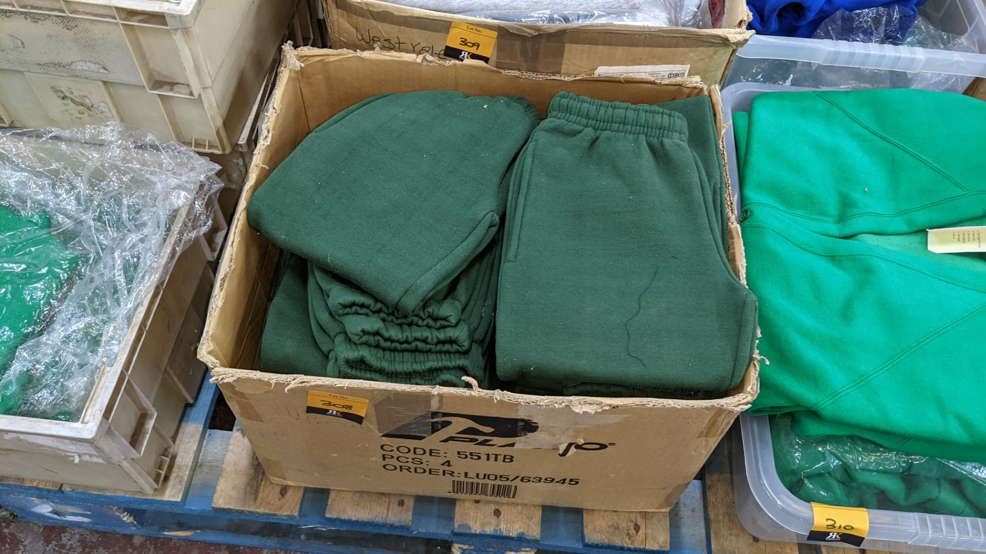 Box of green children's tracksuit bottoms