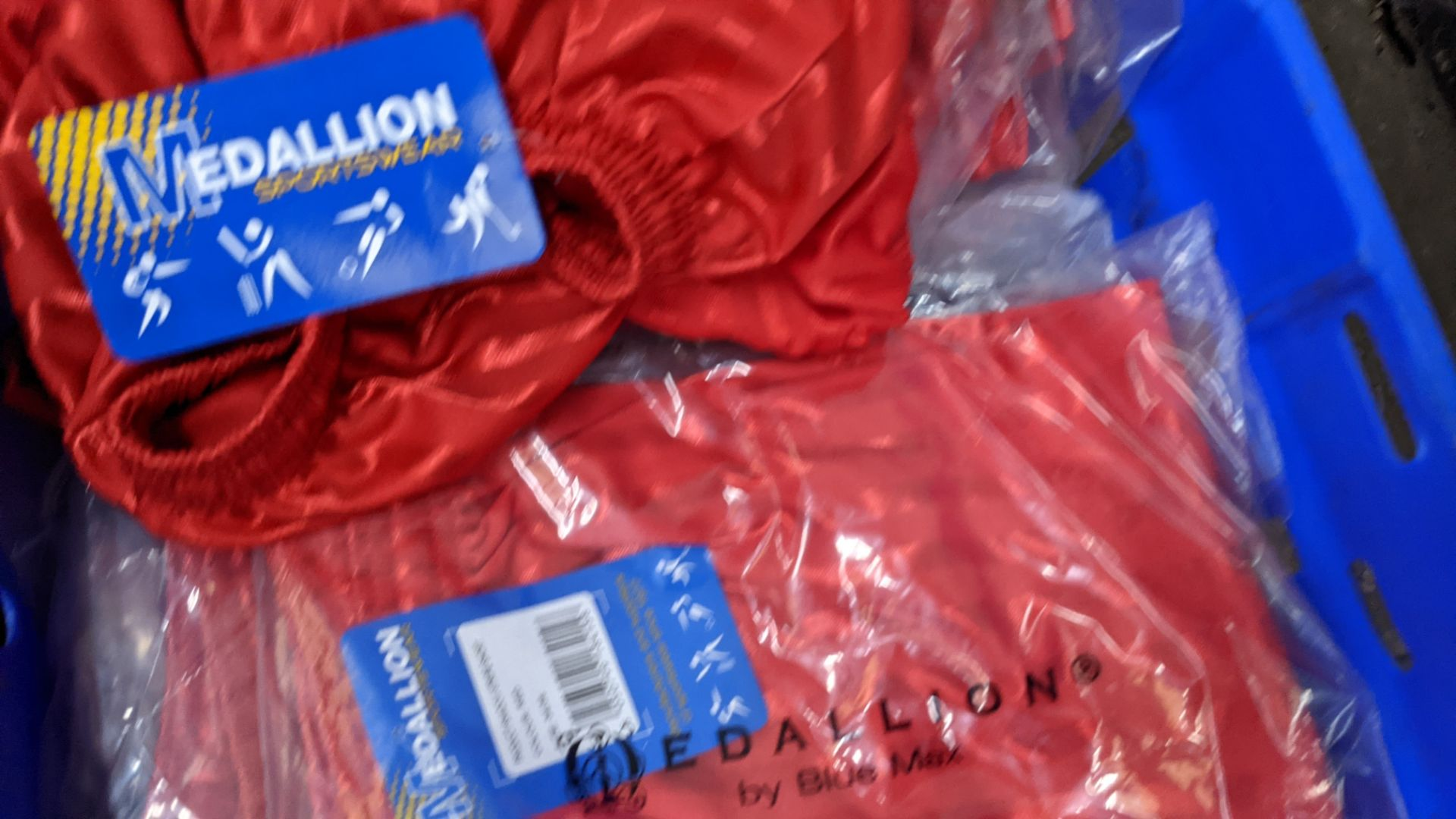 Approx 20 off red children's sports shorts - Image 4 of 5