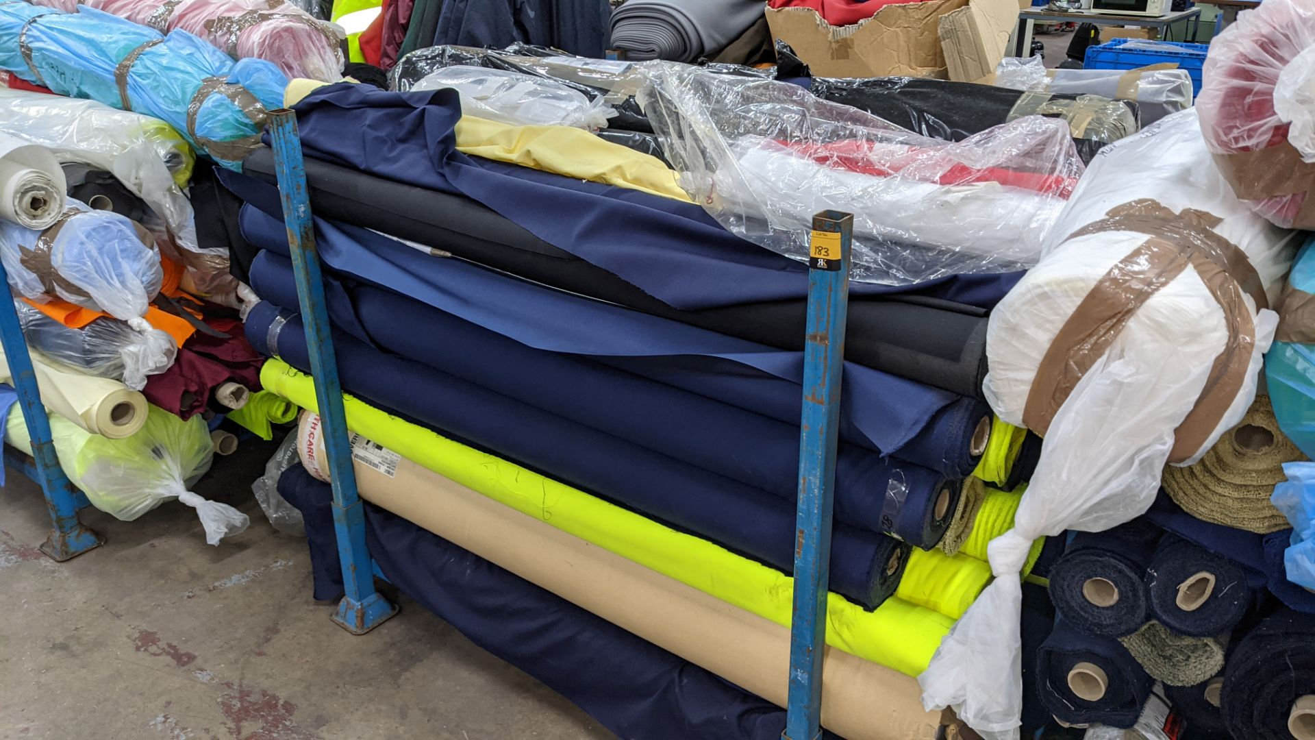 The contents of a large stillage of fabric including quantity of high visibility cloth. Please note - Image 8 of 8