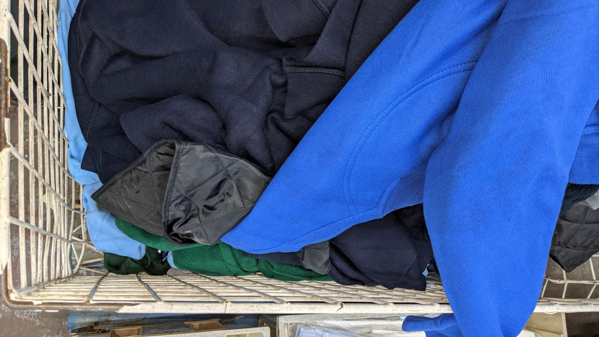 The contents of a cage of assorted adults garments. NB cage excluded - Image 4 of 5