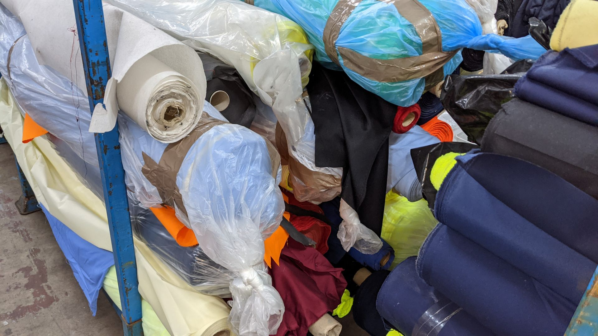 The contents of a large stillage of fabric including quantity of high visibility cloth. Please note - Image 9 of 12