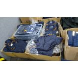 The contents of a pallet of short sleeve zip up navy tops with white or orange collars - this lot co