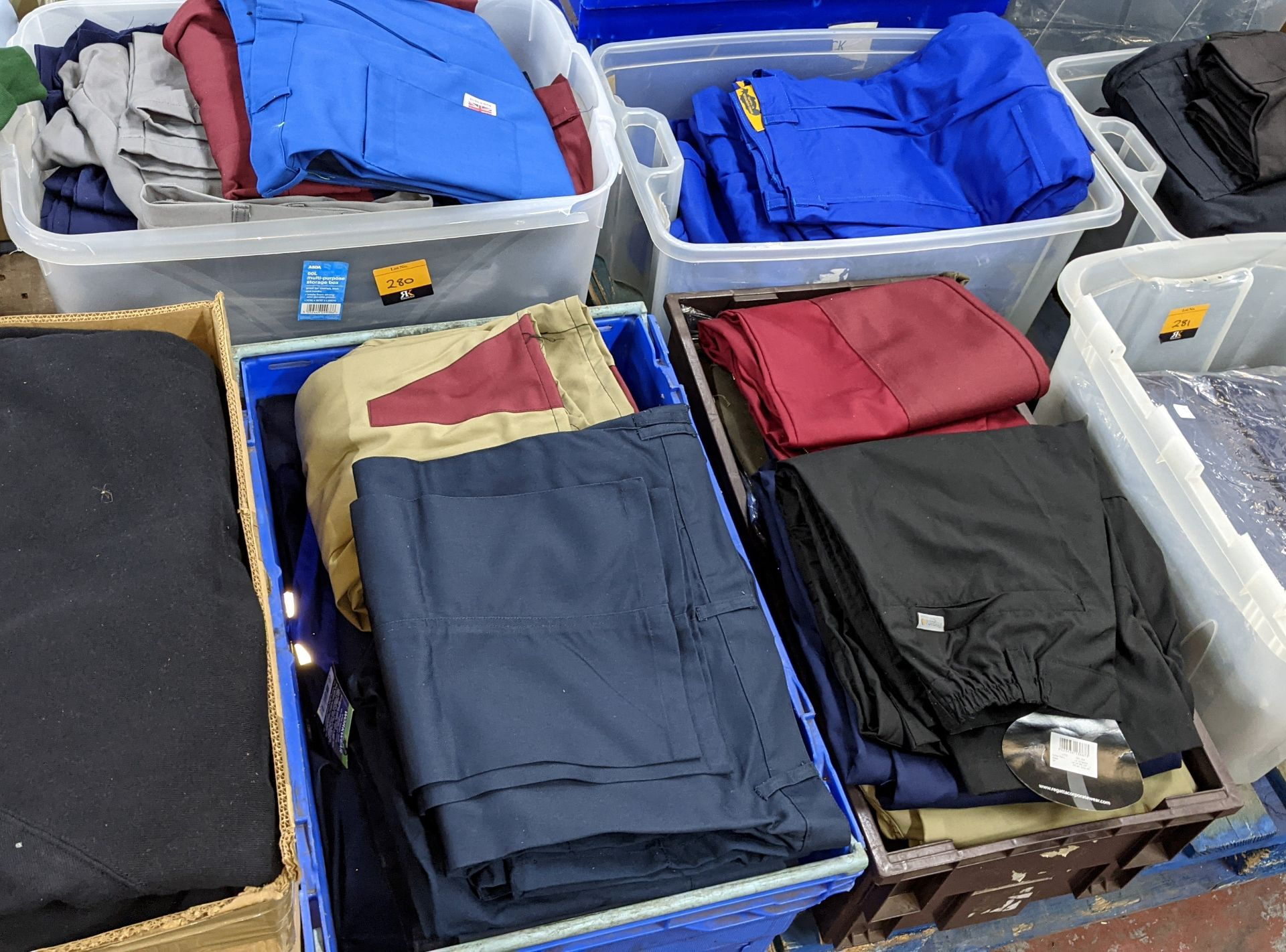The contents of 4 crates of assorted work trousers. NB crates excluded