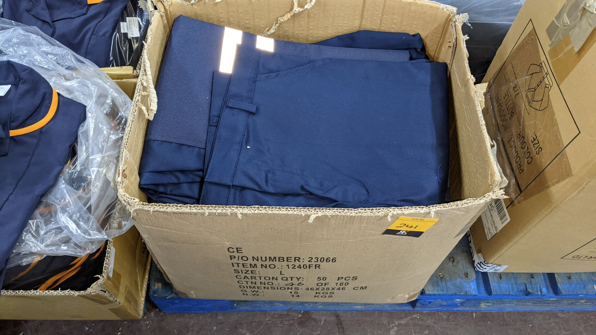 Box of blue work trousers with silver stripes