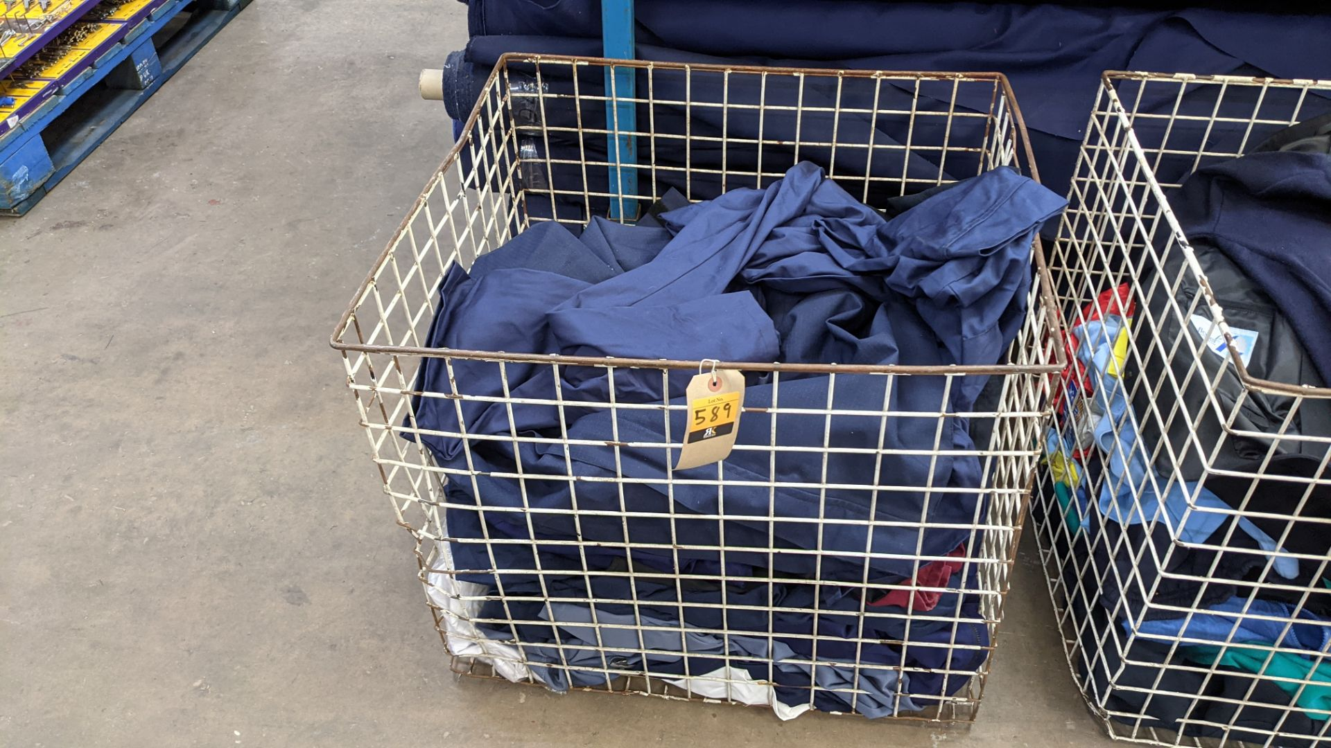The contents of a cage of workwear & overalls