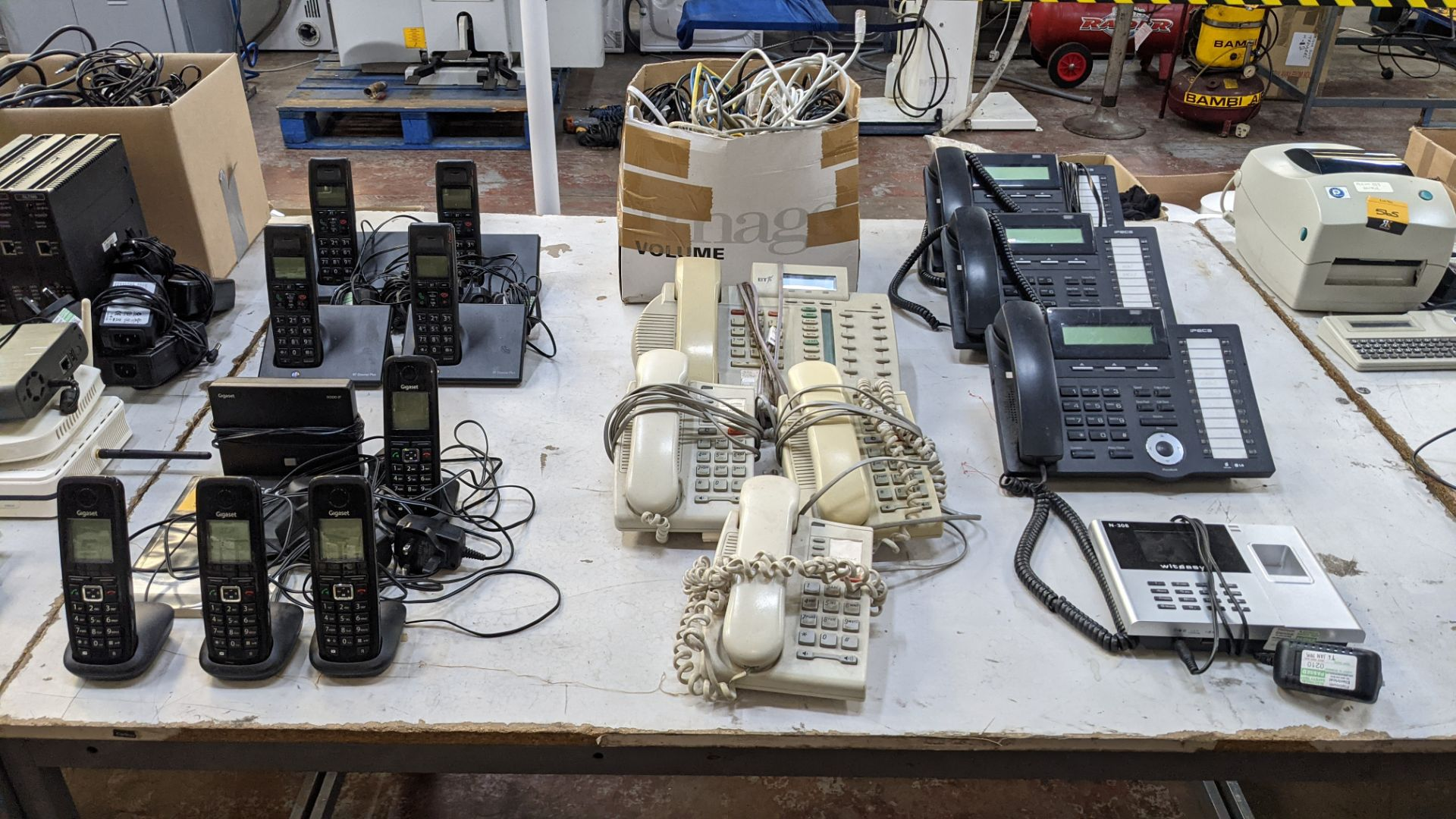 The contents of a table of telephone equipment comprising DECT cordless handsets & office phones - Image 2 of 8