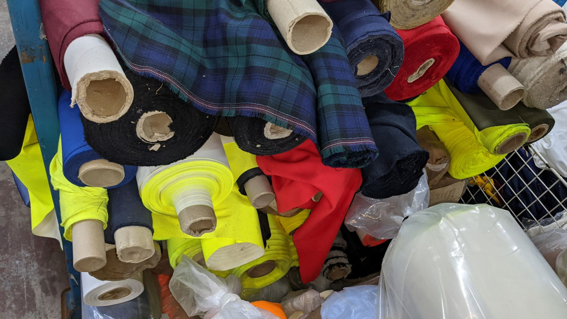 The contents of a large stillage of fabric including quantity of high visibility cloth. Please note - Image 8 of 9