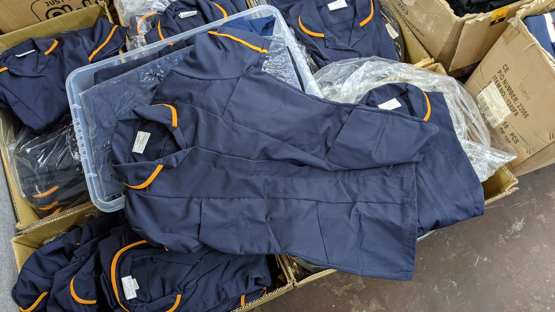 The contents of a pallet of short sleeve zip up navy tops with white or orange collars - this lot co - Image 6 of 6
