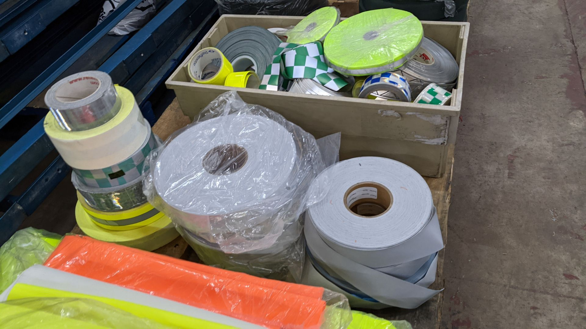 Quantity of hi-vis & reflective fabric & trim comprising 1 stack of fabric, 1 row of reels & the con - Image 7 of 9