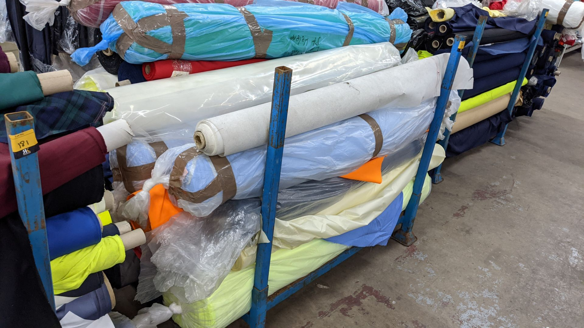 The contents of a large stillage of fabric including quantity of high visibility cloth. Please note - Image 2 of 12