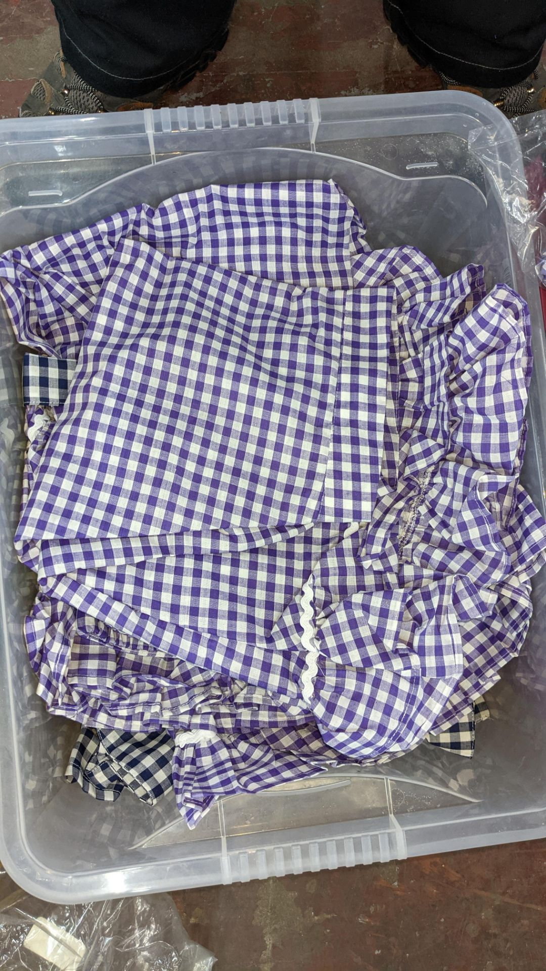 The contents of a crate of children's check skirts. NB crate excluded - Image 6 of 6