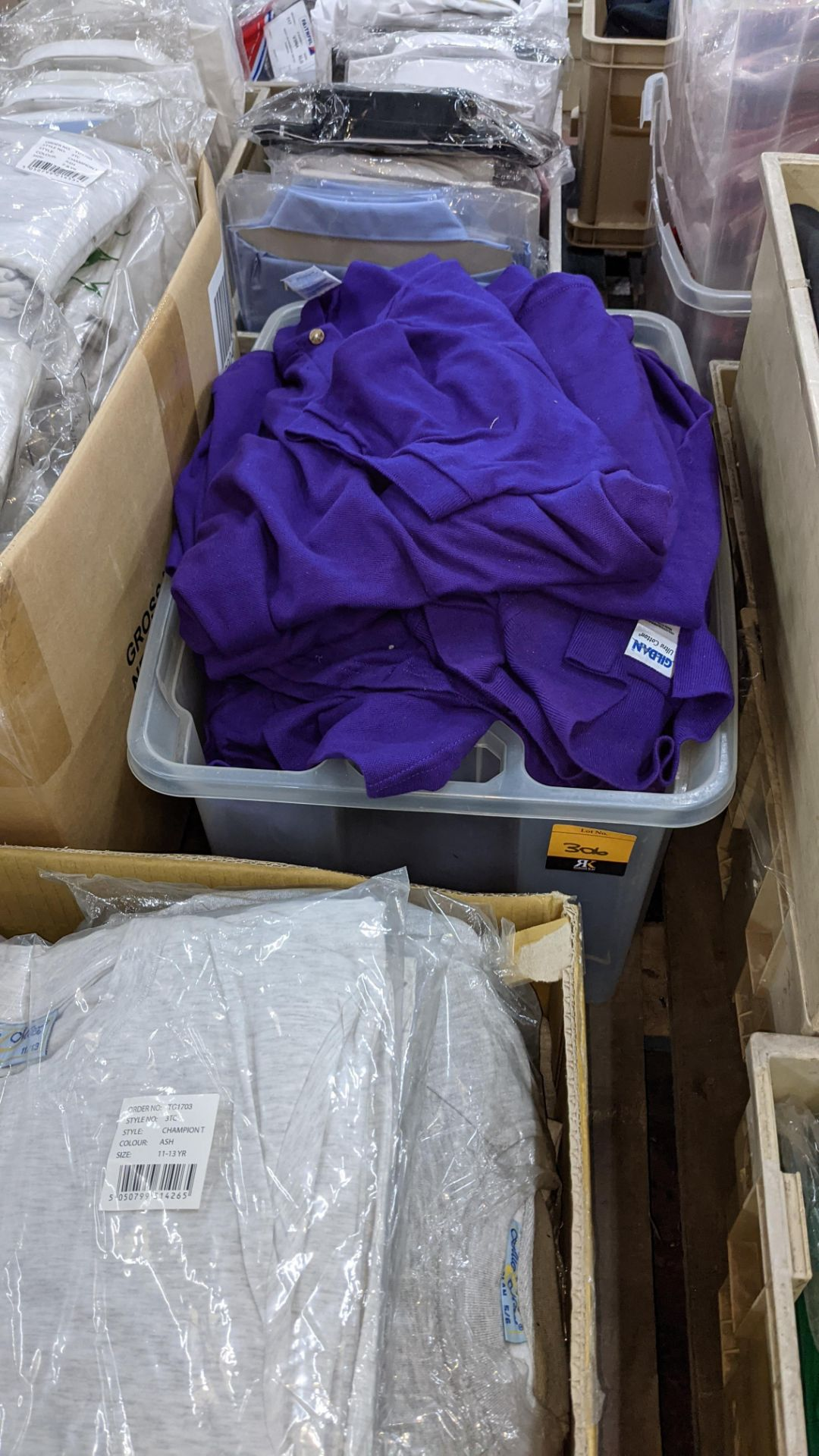 Quantity of Gildan purple polo shirts - the contents of 1 crate. NB crate excluded