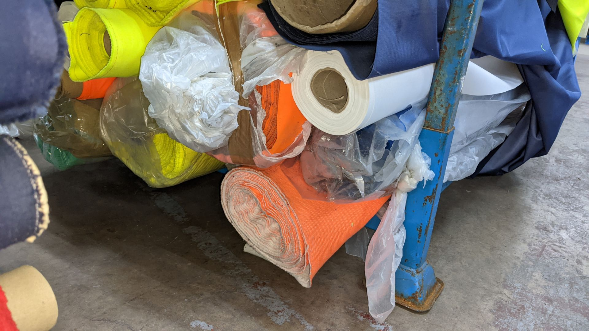 The contents of a large stillage of fabric including quantity of high visibility cloth. Please note - Image 6 of 9