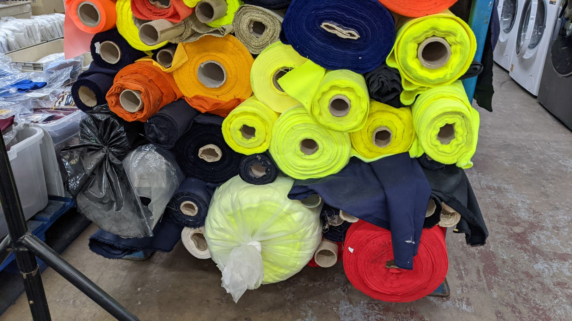 The contents of a large stillage of fabric including quantity of high visibility cloth. Please note - Image 6 of 10