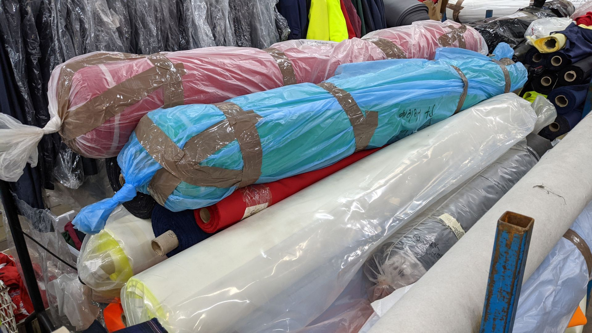 The contents of a large stillage of fabric including quantity of high visibility cloth. Please note - Image 4 of 12