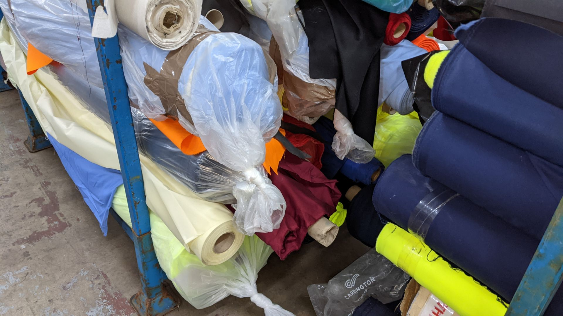 The contents of a large stillage of fabric including quantity of high visibility cloth. Please note - Image 10 of 12
