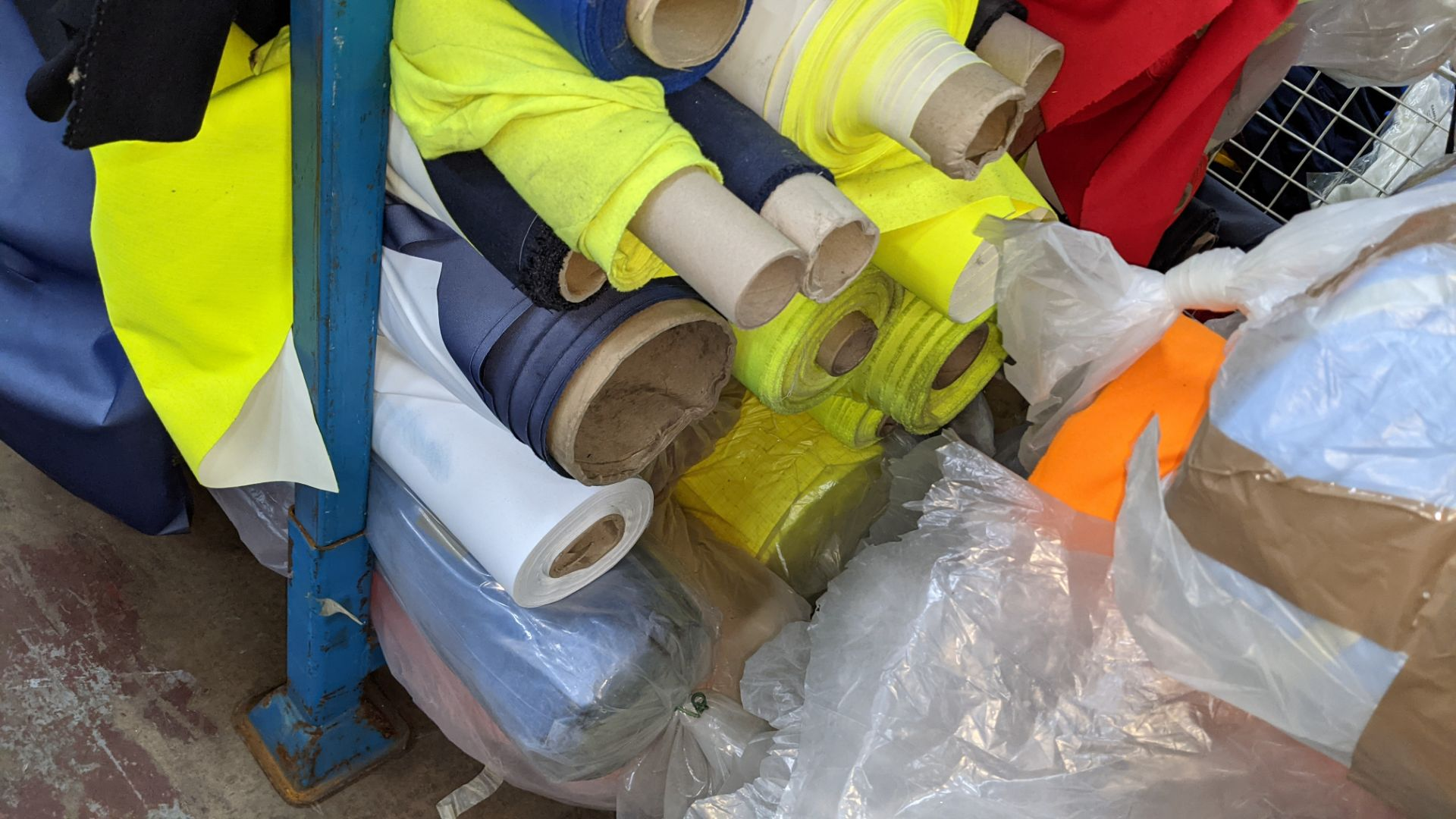The contents of a large stillage of fabric including quantity of high visibility cloth. Please note - Image 9 of 9