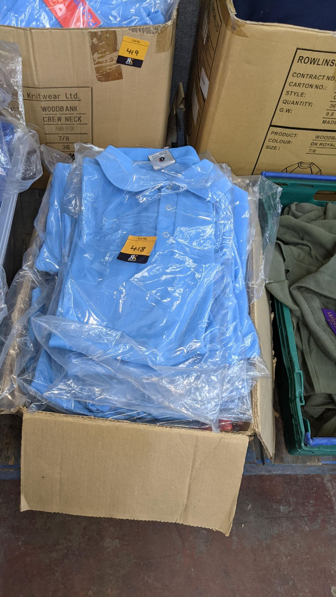 Approx 25 off pale blue polo shirts