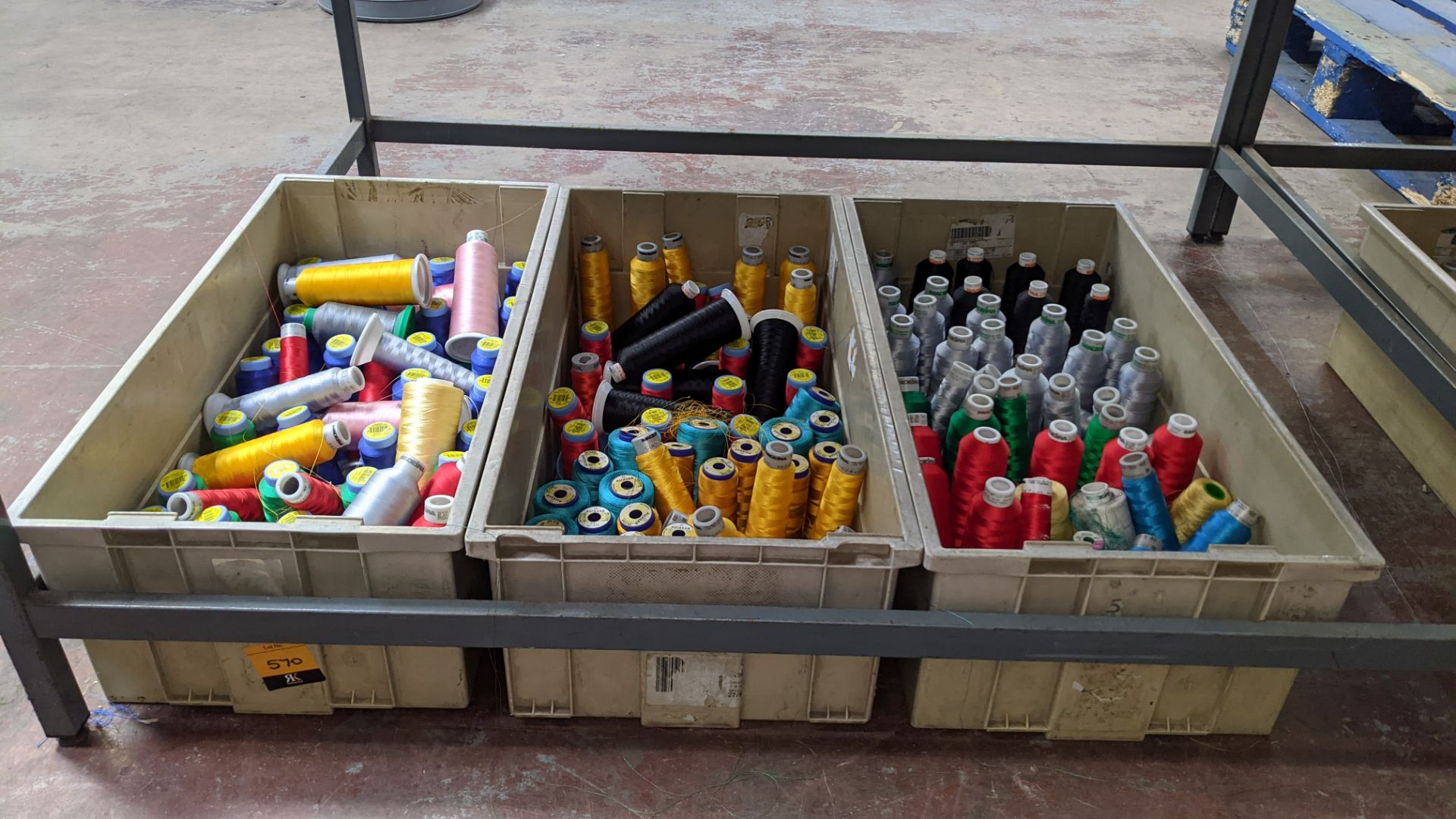 The contents of 3 large crates of assorted embroidery thread