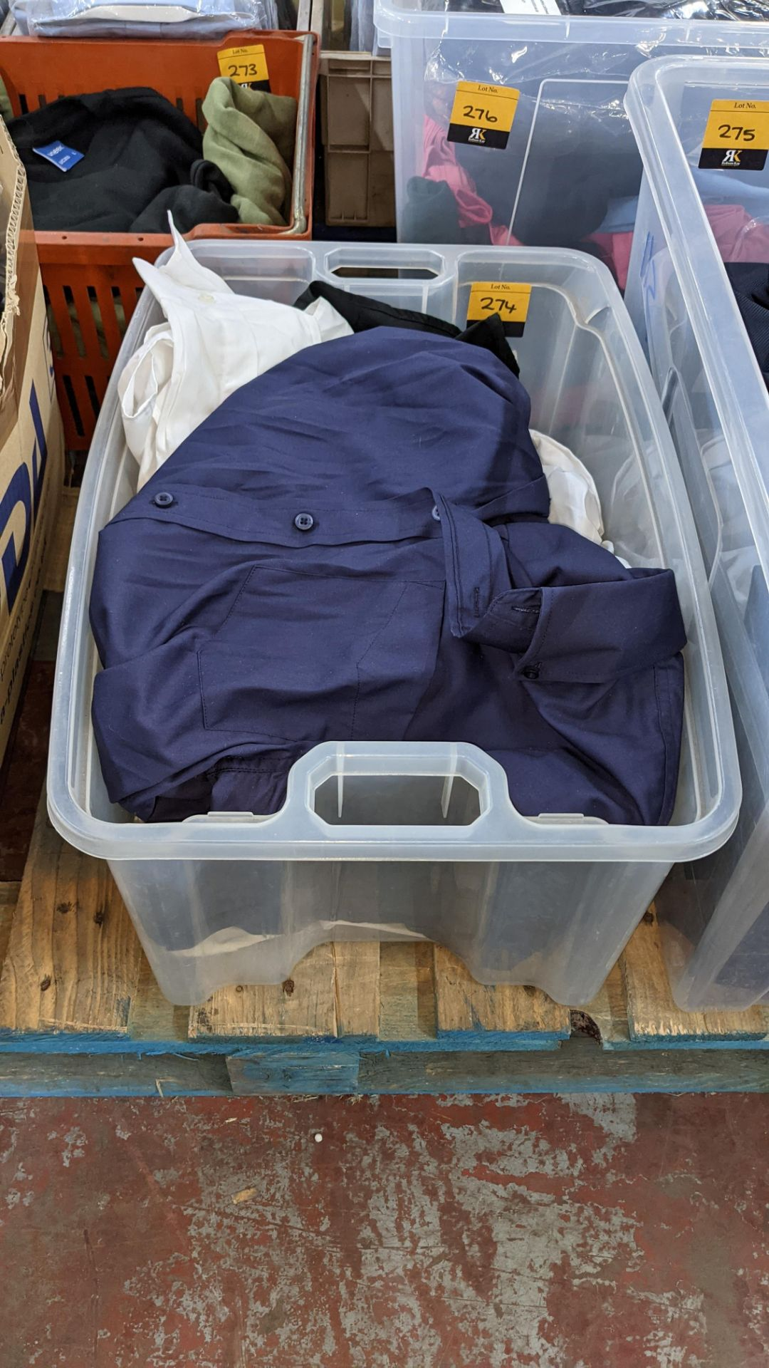 The contents of a crate of shirts. NB crate excluded