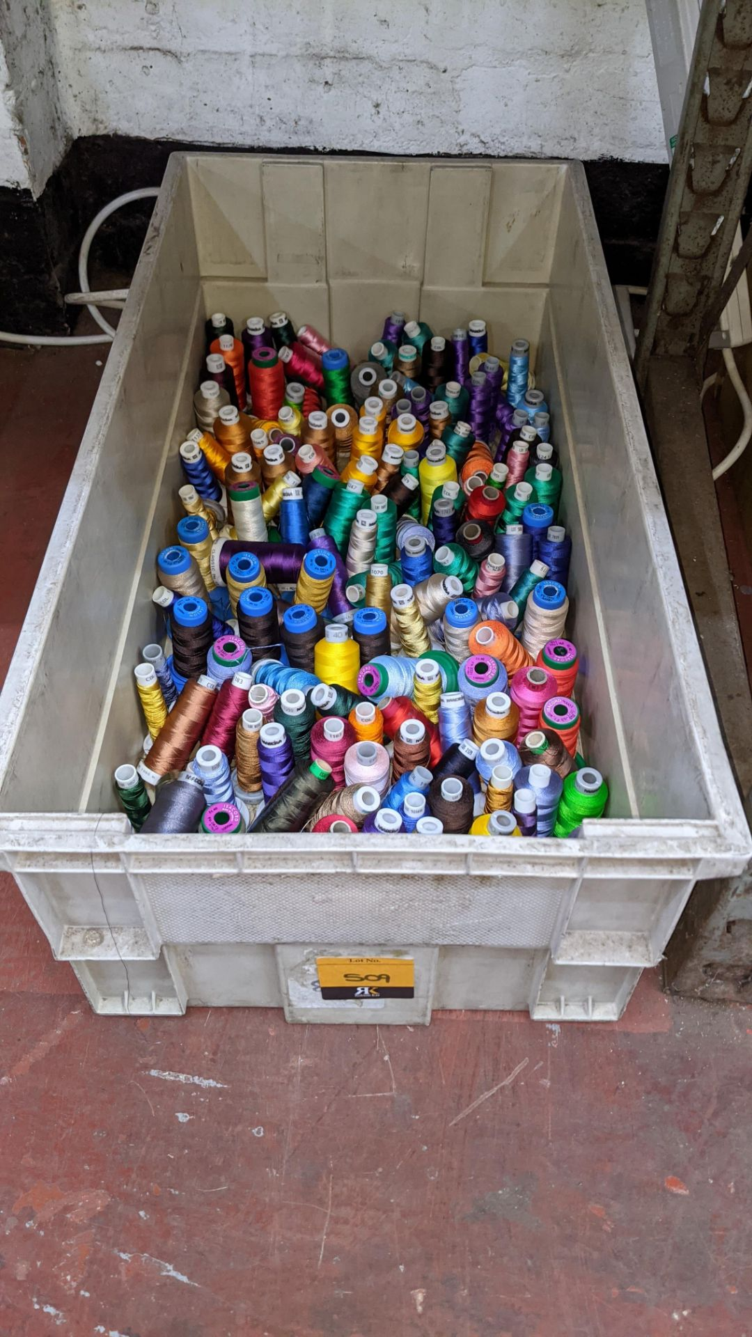 The contents of a large crate of assorted thread